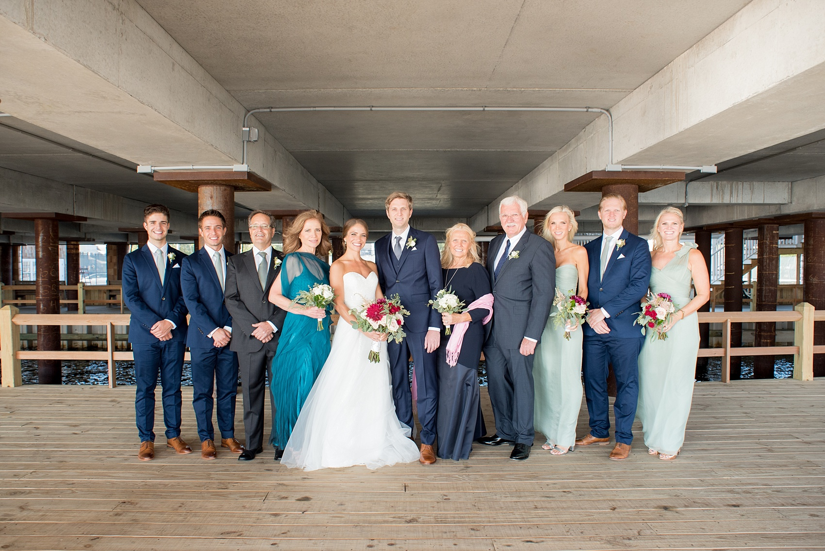 Mikkel Paige Photography picture of a Bay Head Yacht Club nautical wedding. The bride and groom's family pose for a photo.