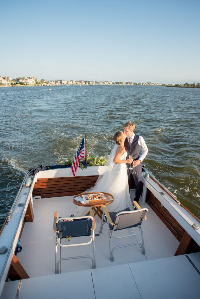 Mikkel Paige Photography picture of a Bay Head Yacht Club nautical wedding. The bride and groom took a vintage 1950's boat to their reception.