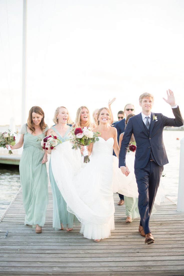 Mikkel Paige Photography picture of a Bay Head Yacht Club nautical wedding. The bride and groom arrive to their reception on the water.