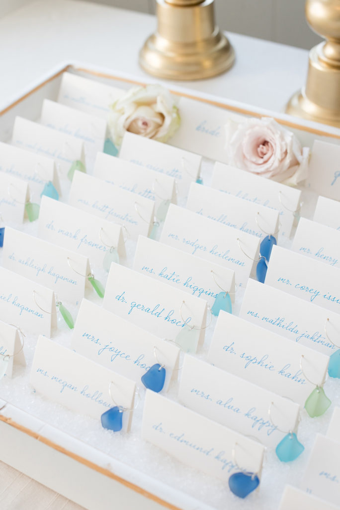 Nautical themed fall wedding at Bay Head Yacht Club in New Jersey, by Mikkel Paige Photography (@mikkelpaige) featured in The Knot. Beach glass was fastened to escort cards for guests and served as their favors.