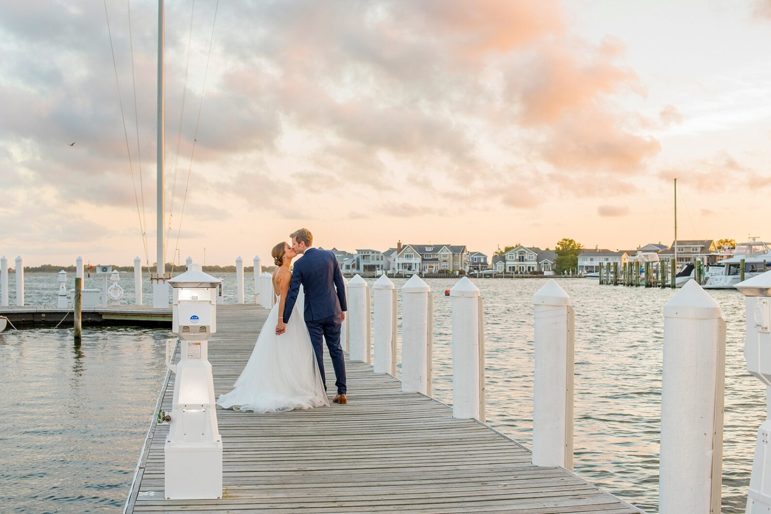 Mikkel Paige Photography sunset bride and groom photo at a wedding at Bay Head Yacht Club on the water in New Jersey.
