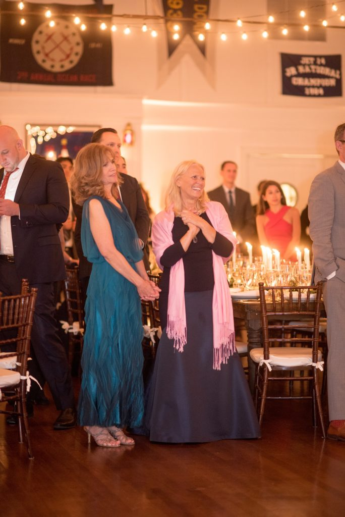 Mikkel Paige Photography picture of a Bay Head Yacht Club nautical wedding. The mothers look on as the bride and groom share their first dance.