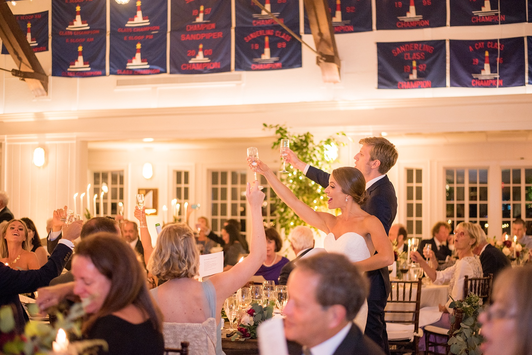 Mikkel Paige Photography reception photo of a wedding at Bay Head Yacht Club on the water in New Jersey. The bride and groom honor his Swedish heritage.