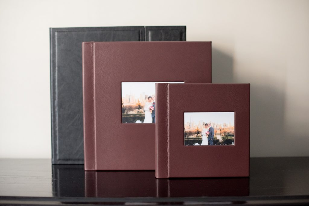 """Mikkel Paige Photography photos of a fine art leather Madera wedding album in Oxblood. 12x12"""" album for the bride and groom and 8x8"""" parent albums."""