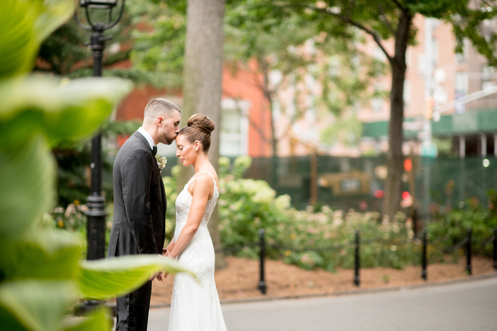 Mikkel Paige Photography captures a luxury wedding in NYC. First look photos in Washington Square Park with a classic bride and groom. Planning by Michelle Elaine Weddings.