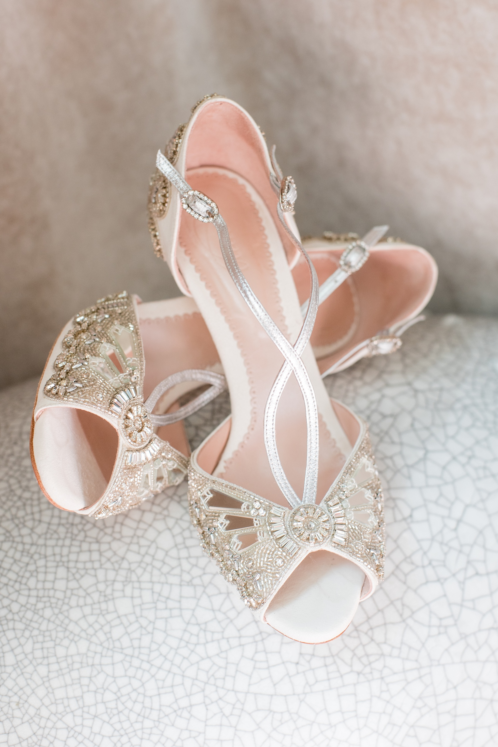 Mikkel Paige Photography captures a luxury wedding in NYC. Detail image of the bride's Emmy London mirrored and silver beaded wedding shoes.
