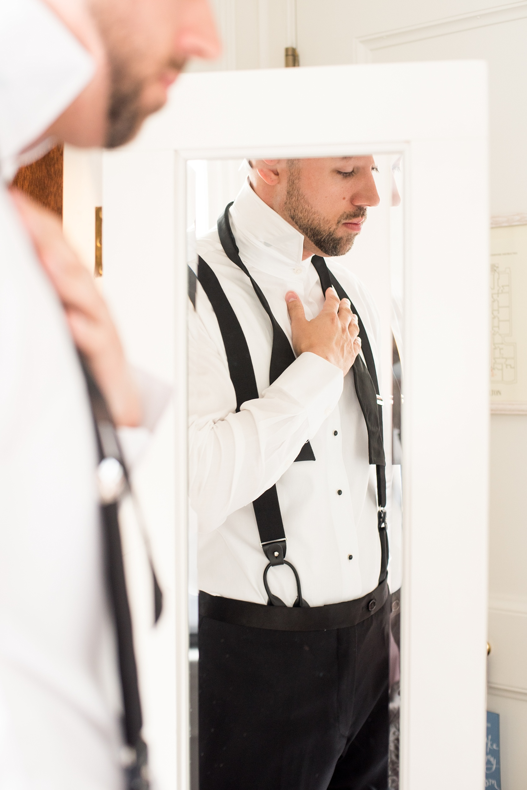 Mikkel Paige Photography photos of a luxury wedding in NYC. Image of the groom getting ready at The Marlton Hotel.