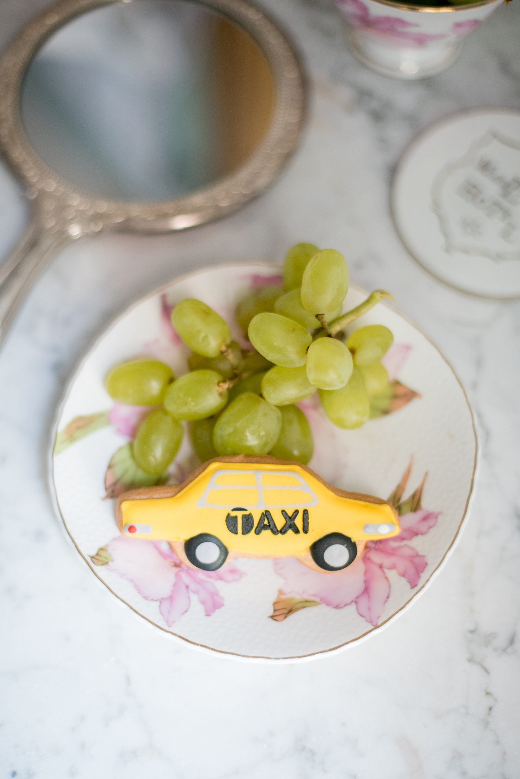 Mikkel Paige Photography photos of a luxury wedding in NYC. Image of a guest favor taxi cab cookie from Eleni's cookies at The Marlton Hotel.