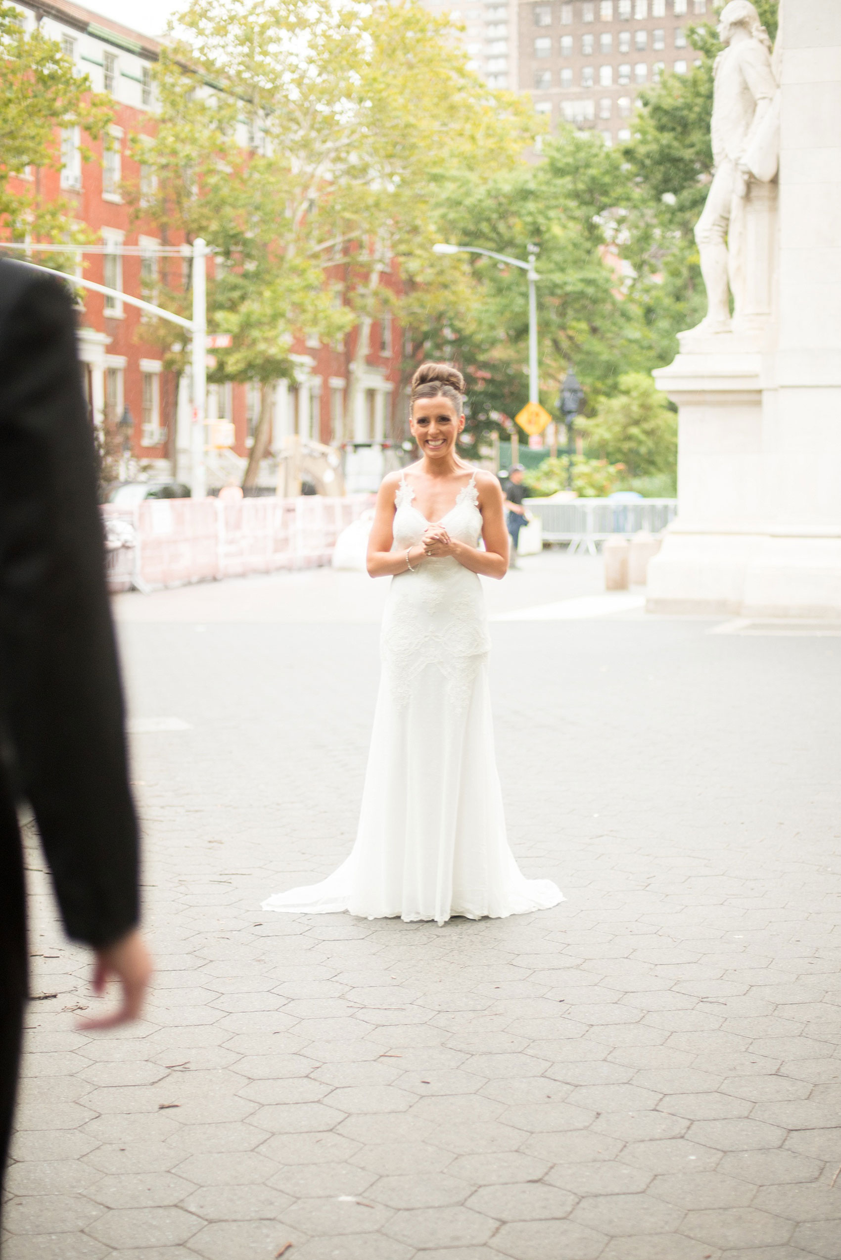 Mikkel Paige Photography photos of a luxury wedding in NYC. First look in Washington Square Park with a picture of the bride in her form fitting David Fielden wedding gown from Kleinfeld's.