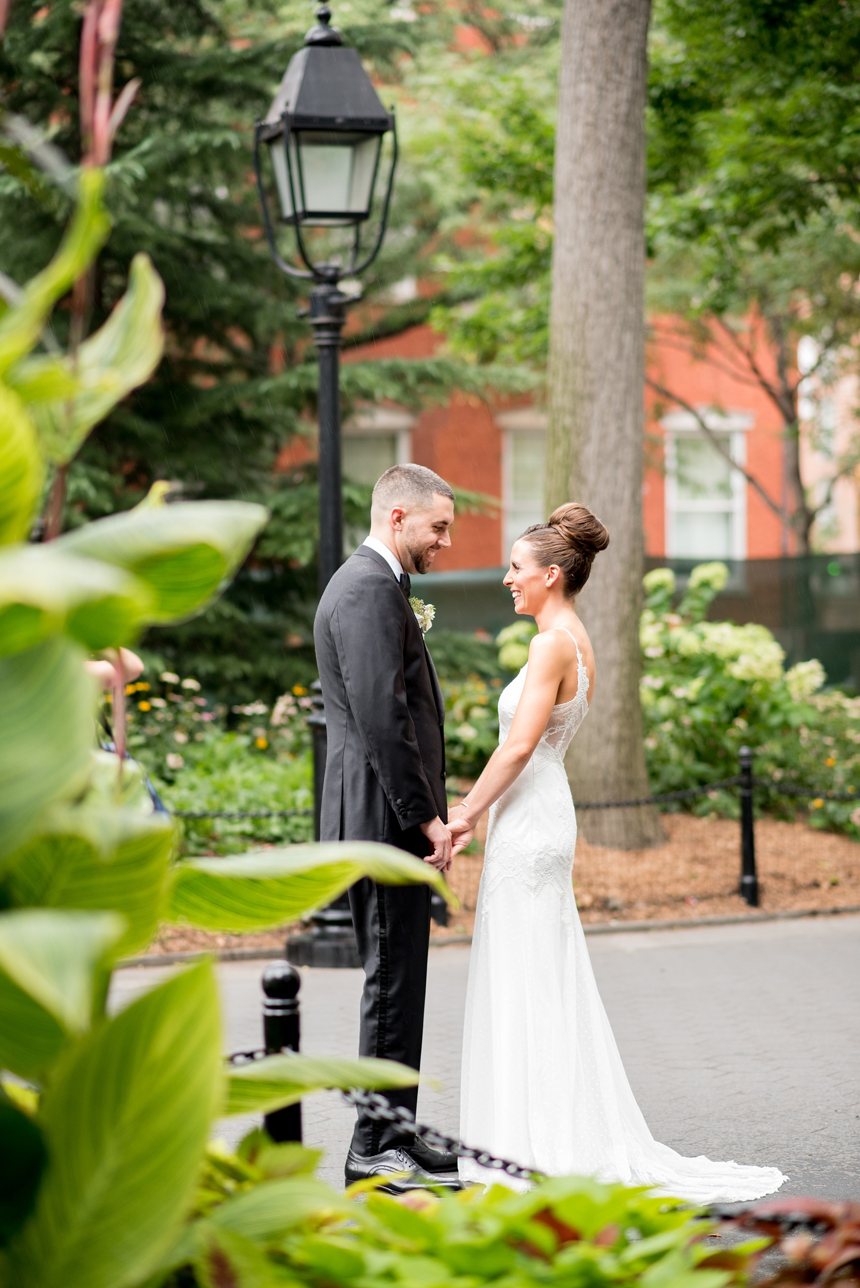Mikkel Paige Photography photos of a luxury wedding in NYC. Image of the bride and groom in Washington Square Park.