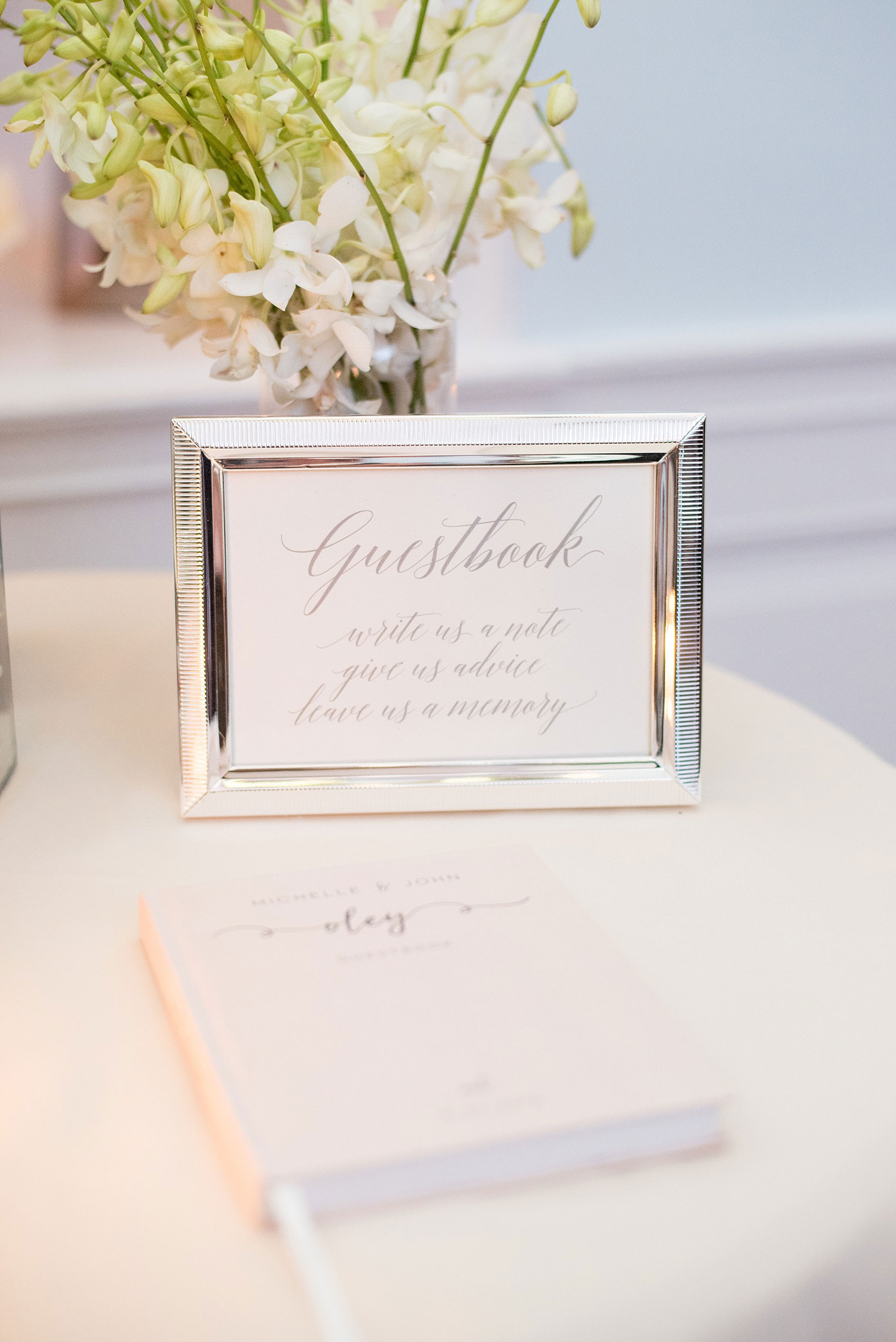 Mikkel Paige Photography photos of a luxury wedding in NYC. Image of the India House reception with calligraphy sign for the guestbook.