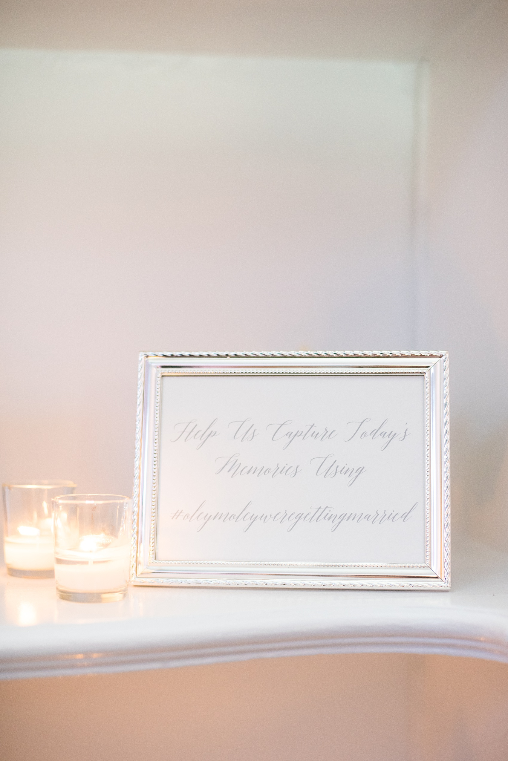 Mikkel Paige Photography photos of a luxury wedding in NYC. Image of the India House reception with calligraphy sign for their hashtag and social media.