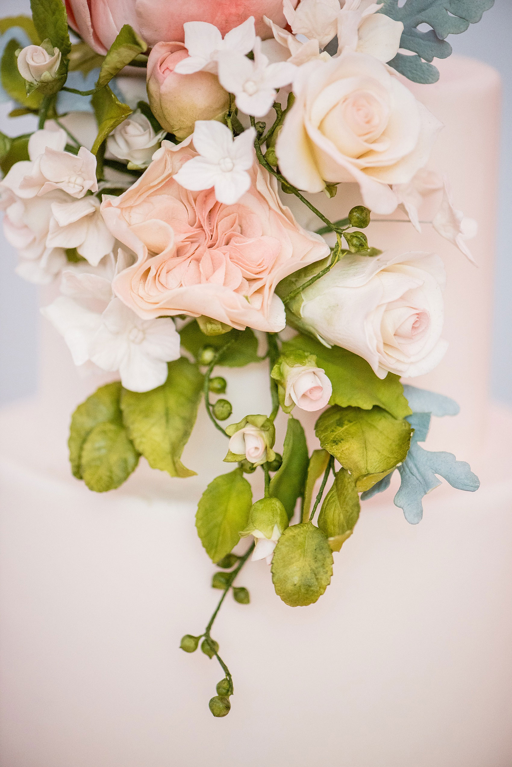 Mikkel Paige Photography photos of a luxury wedding in NYC. Image of India House reception and elegant white tiered cake with gumpaste flowers by Madison Lee.