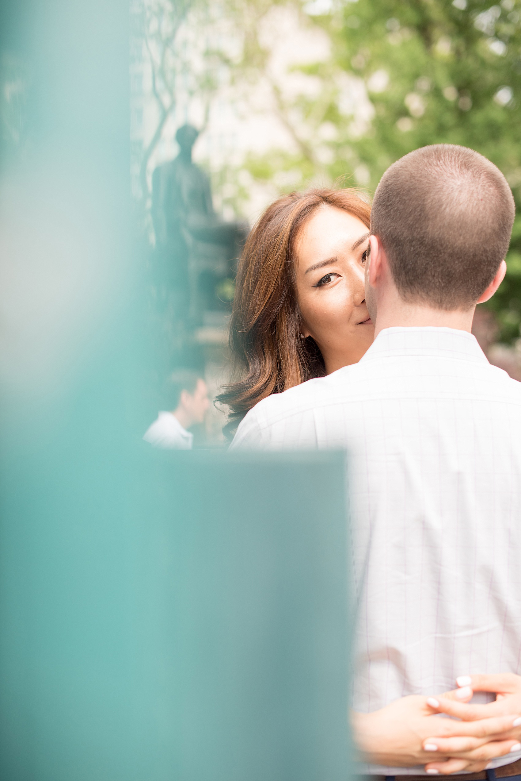 Mikkel Paige Photography photos of a Madison Square Park engagement session in NYC by the subway entrance.