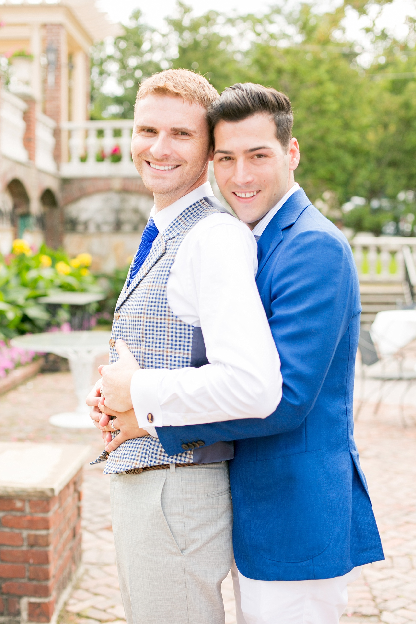 Mikkel Paige Photography photos of a gay wedding at The Manor in West Orange, NJ. The grooms wore a plaid vest and blue suit.