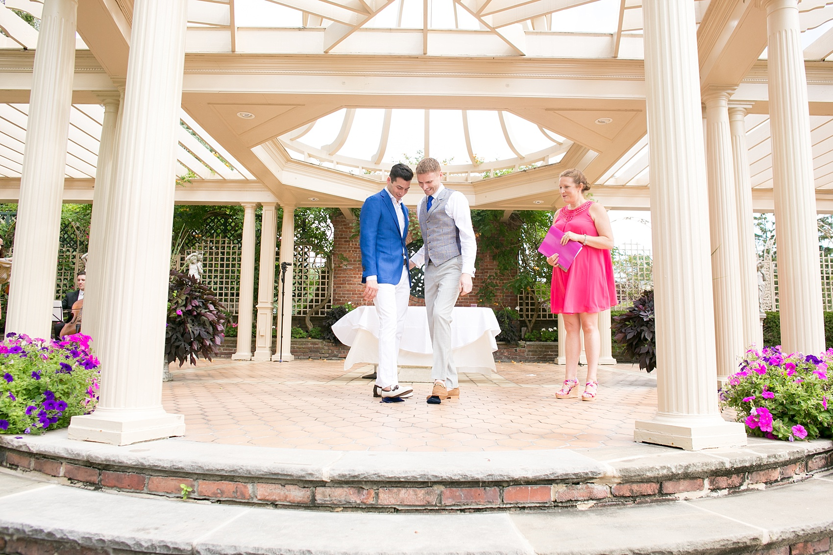 Mikkel Paige Photography photos of a gay wedding at The Manor in West Orange, NJ. Image of grooms stepping on the glass during their outdoor ceremony.
