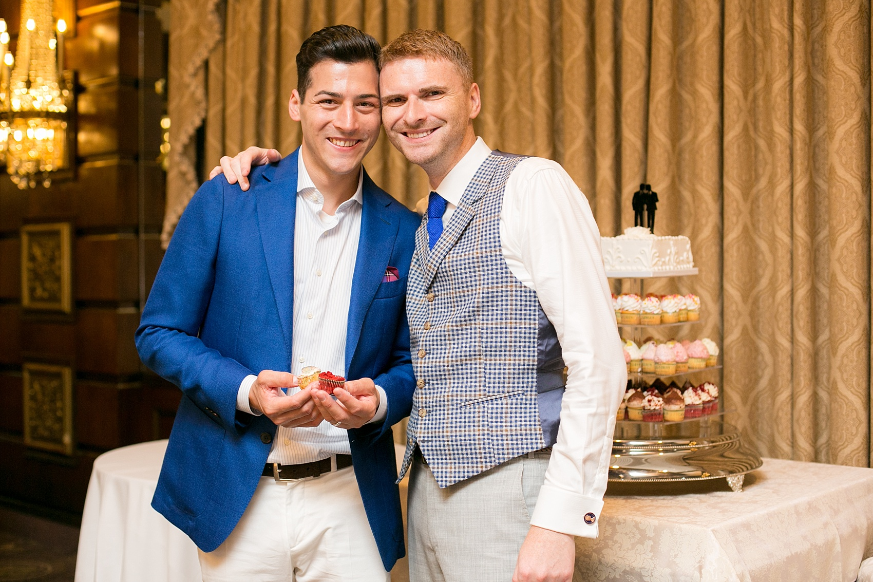 Mikkel Paige Photography photos of a gay wedding at The Manor in West Orange, NJ. The grooms chose a cupcake tower for a cake cutting.
