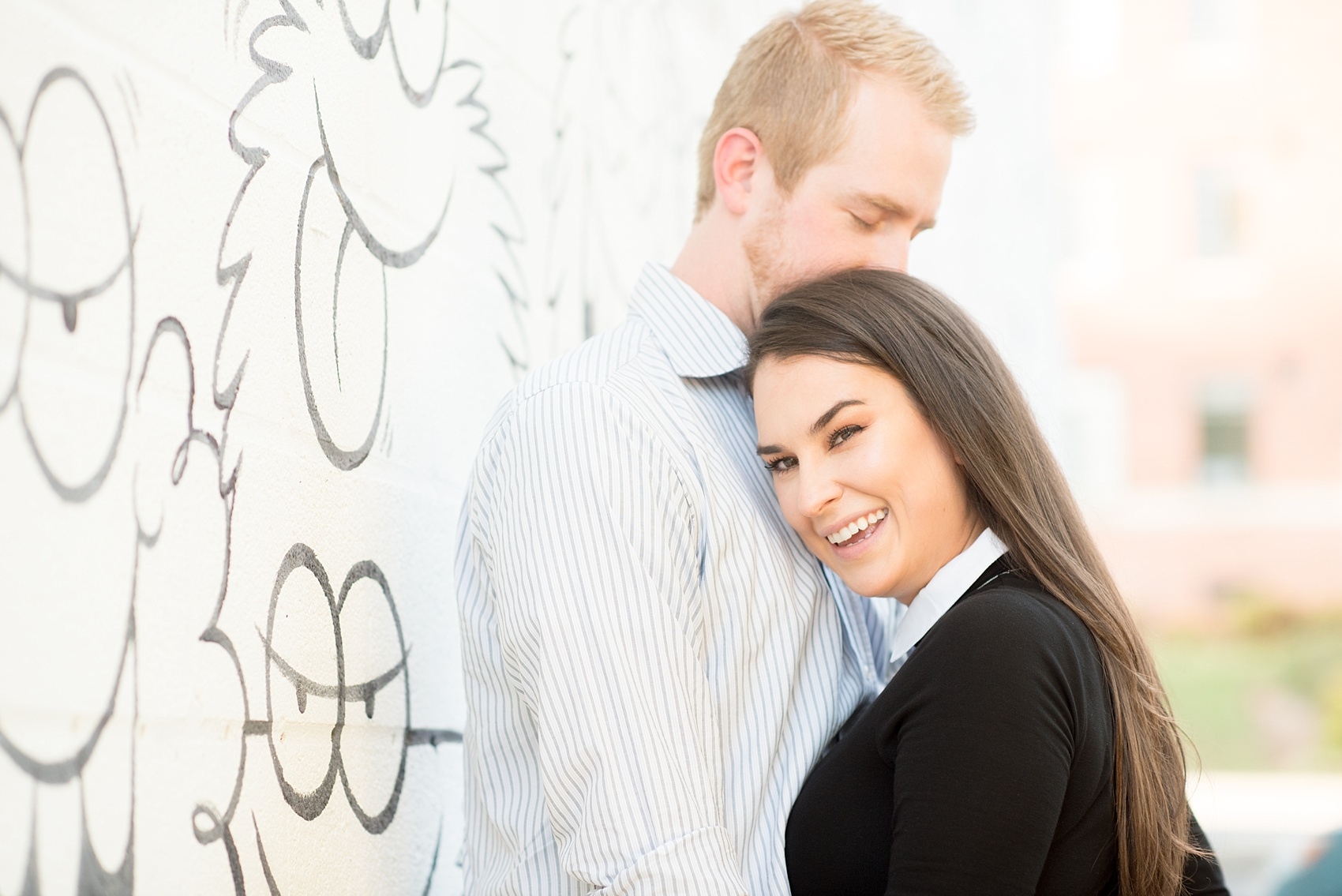 Mikkel Paige Photography photos of a downtown Raleigh engagement session with comical, fun murals.