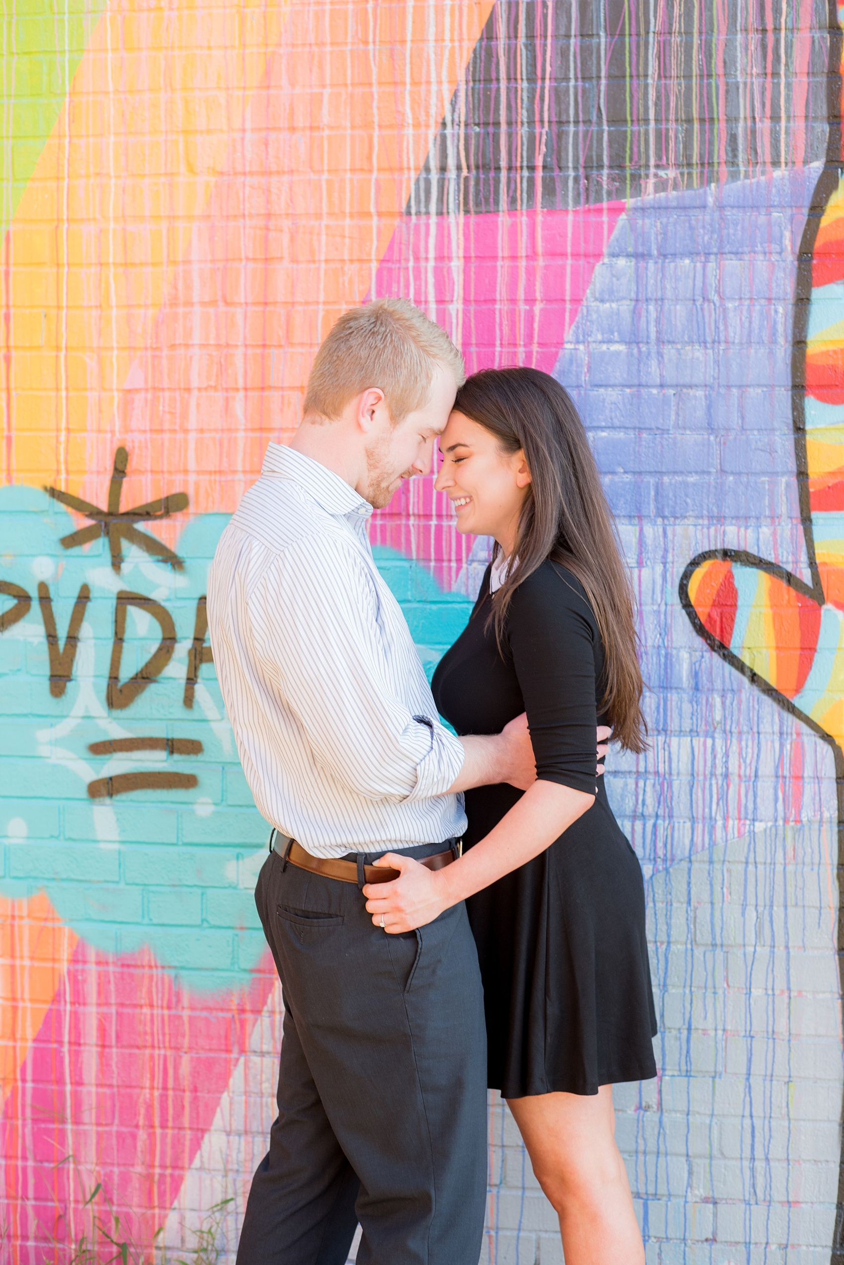 Mikkel Paige Photography photos of a colorful downtown Raleigh engagement session.