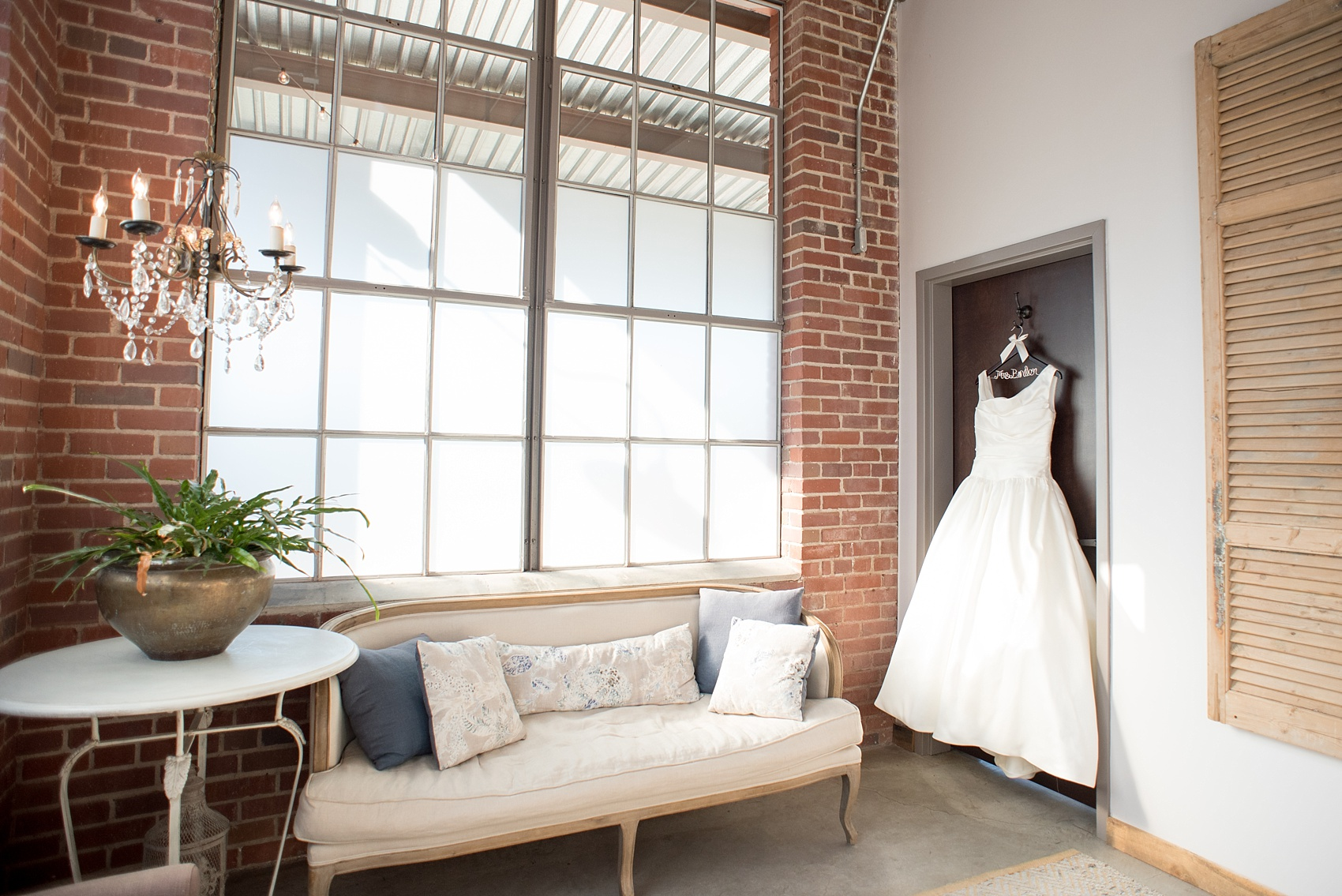 Mikkel Paige Photography photo of a wedding at The Rickhouse, Durham. The bride's white gown hangs in the bridal suite.