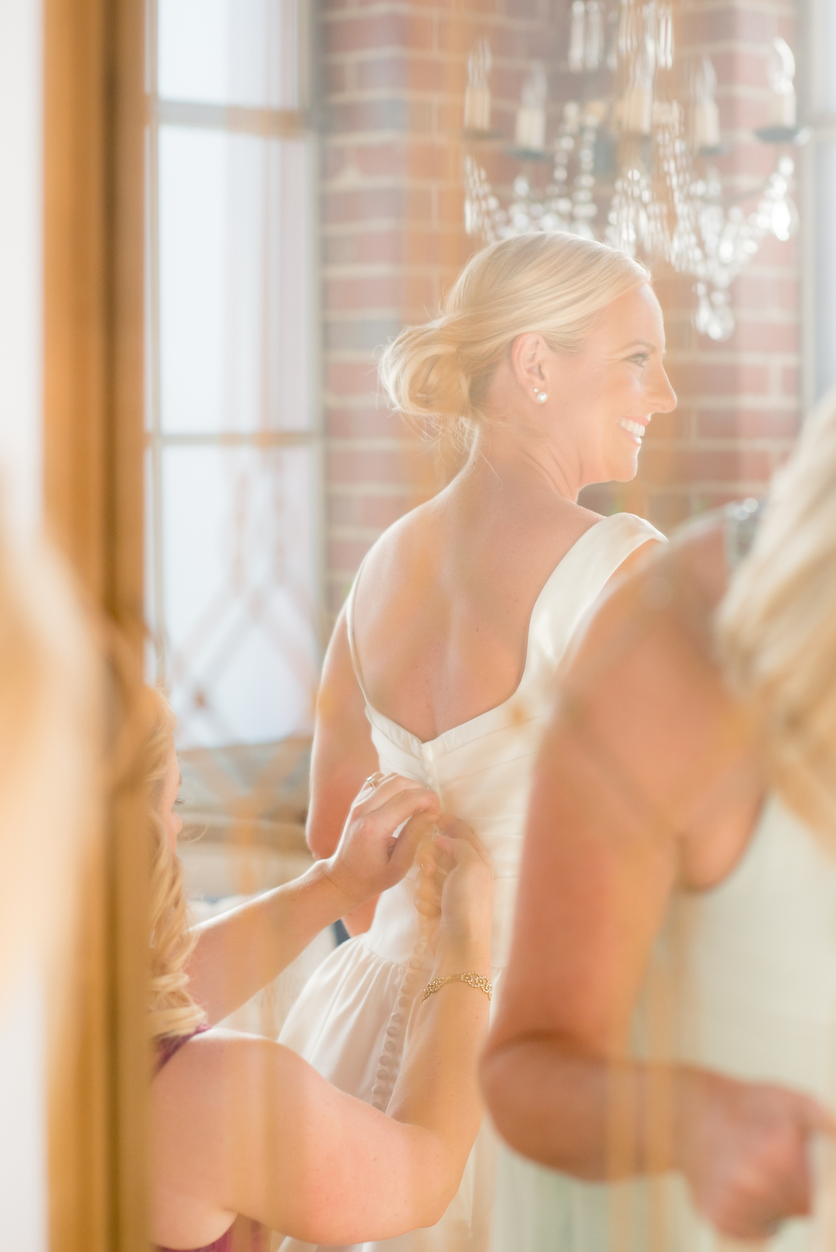 Mikkel Paige Photography photo of a wedding at The Rickhouse, Durham. The bride prepares in the bridal suite.