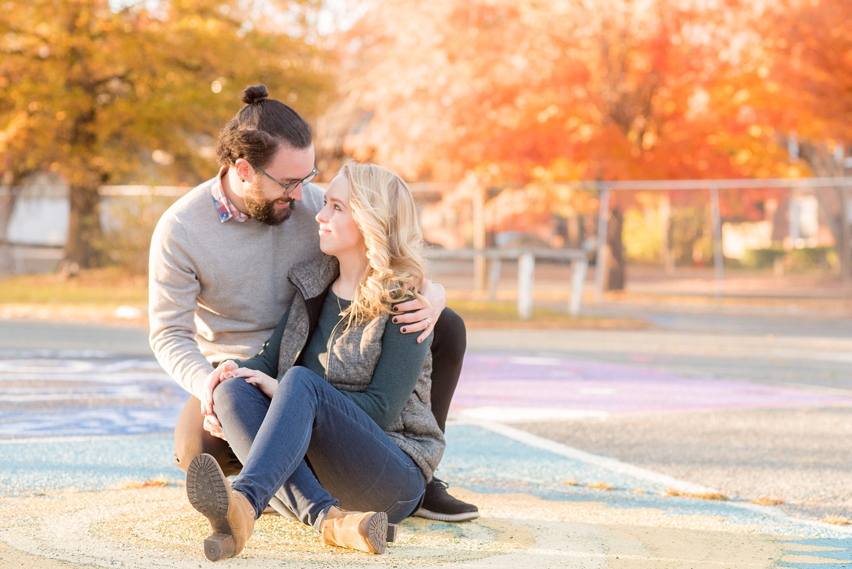 Mikkel Paige Photography photos of a Durham engagement session with colorful parking spaces and fall leaves.