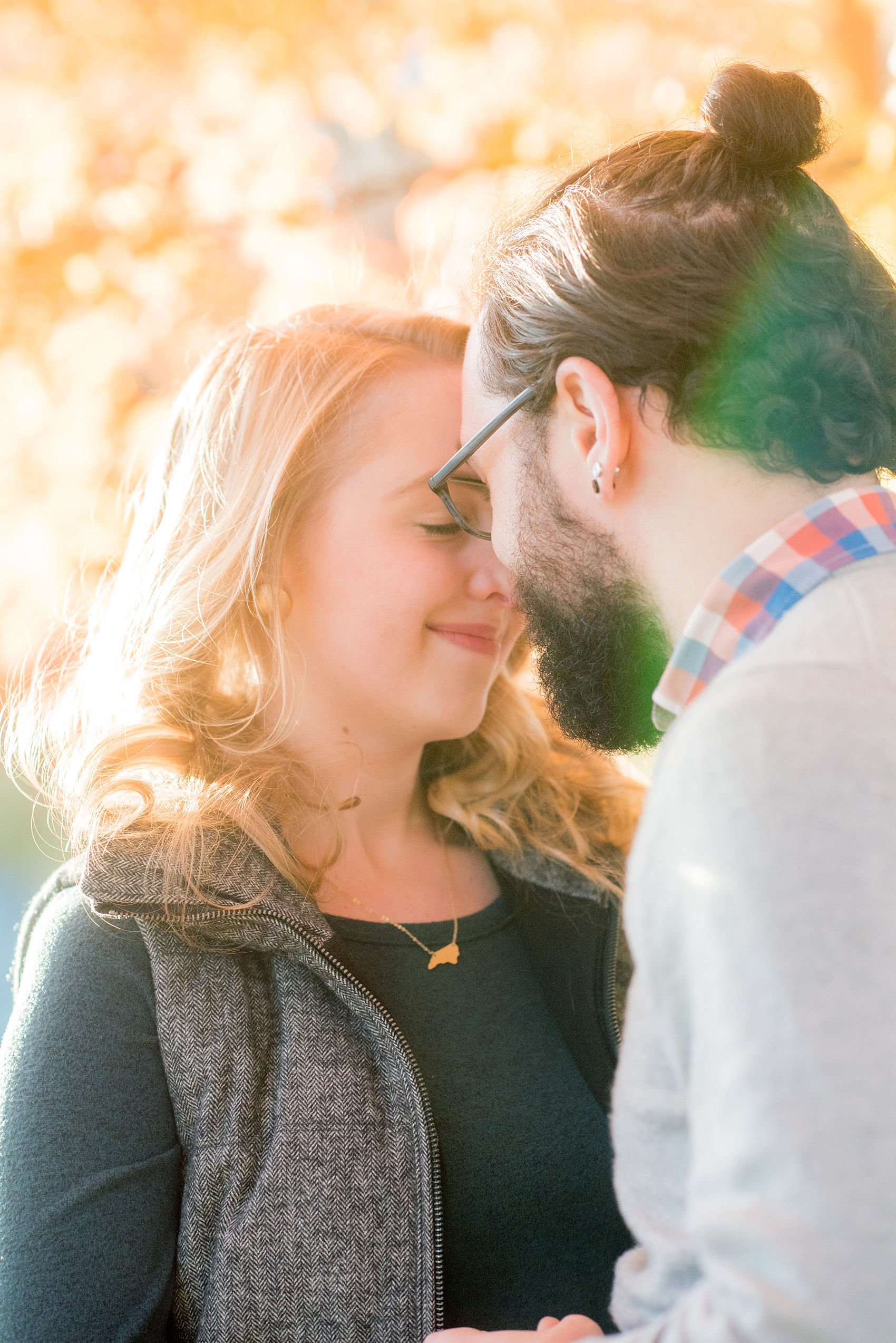 Mikkel Paige Photography photos of a downtown Durham engagement session with a fall leaves and cozy outfits.