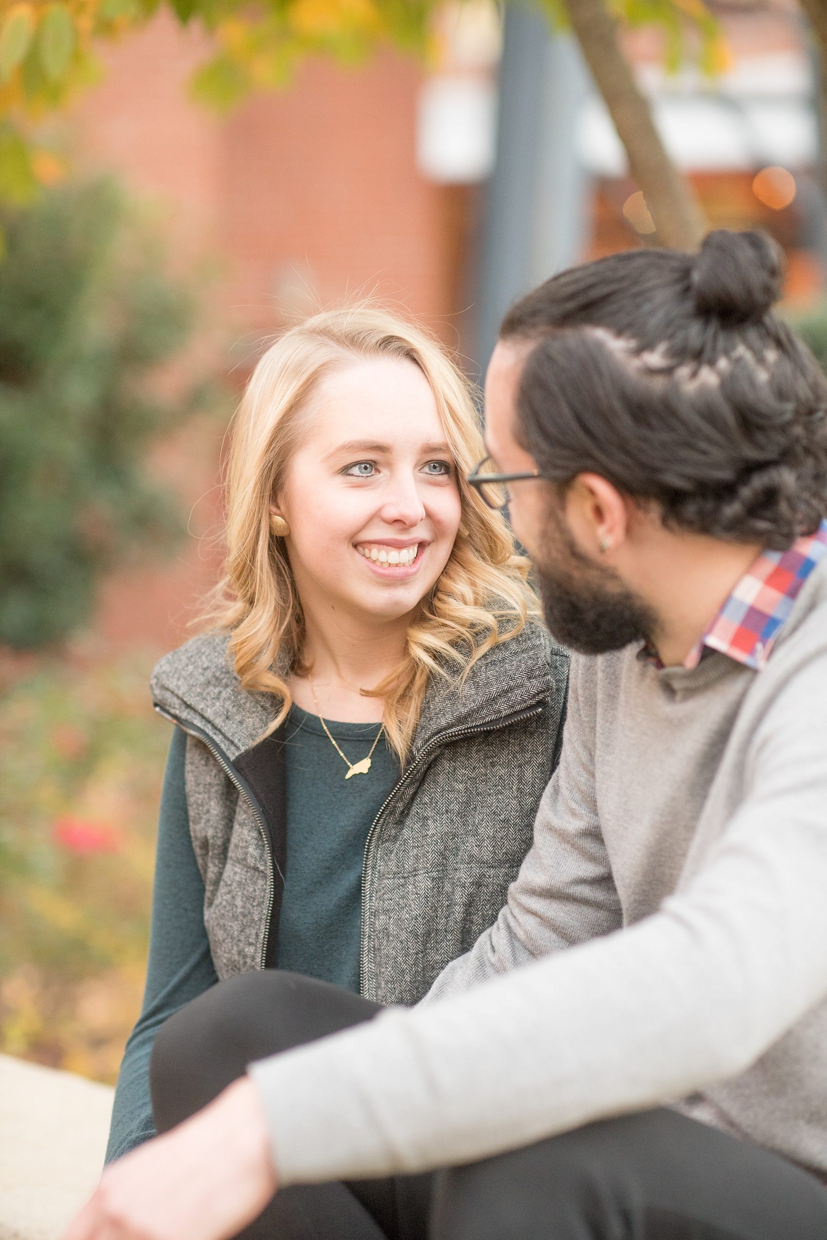 Mikkel Paige Photography photos of a Durham engagement session at American Tobacco Campus with fall leaves.