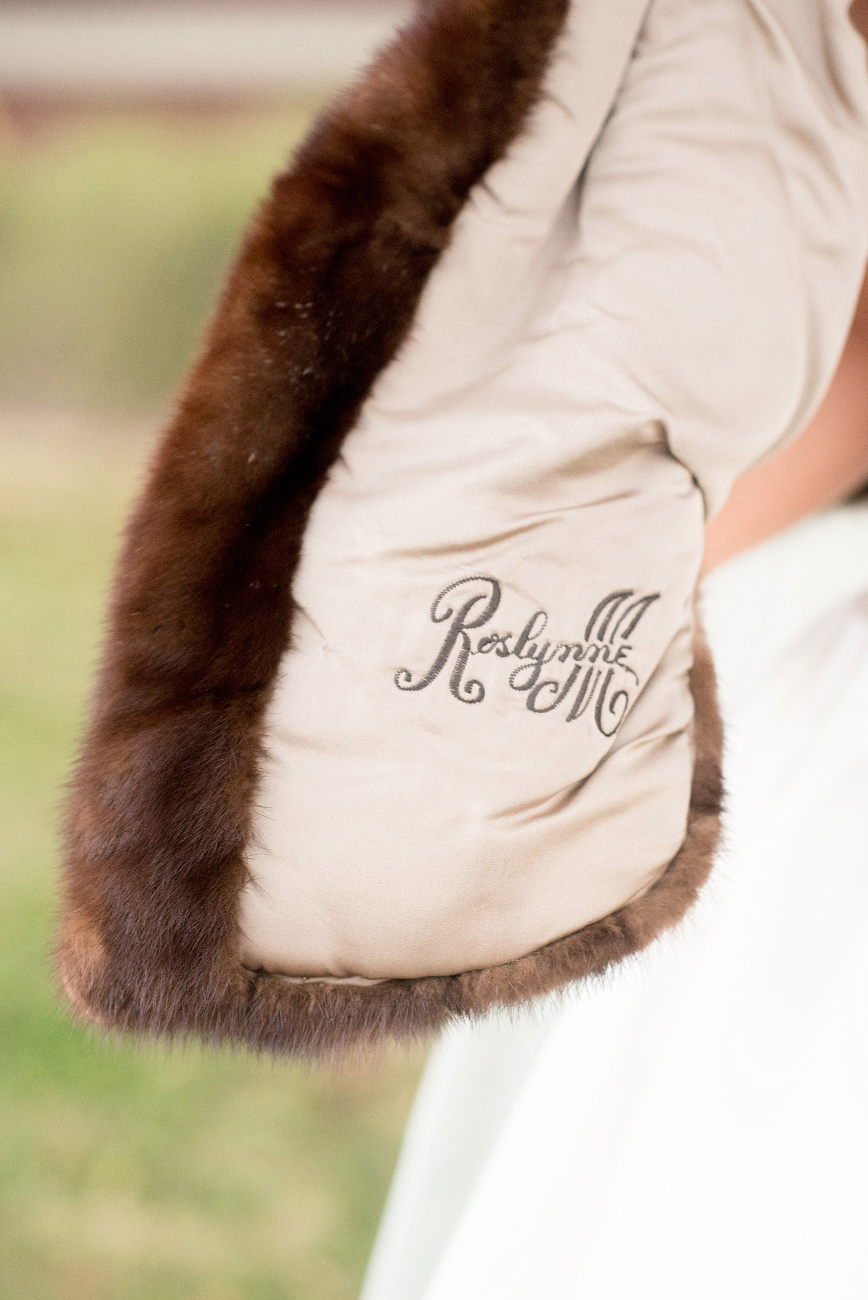 Mikkel Paige Photography photo of a wedding at The Rickhouse, NC. A picture of bride's heirloom fur stahl with her grandmother's name embroidered in it.