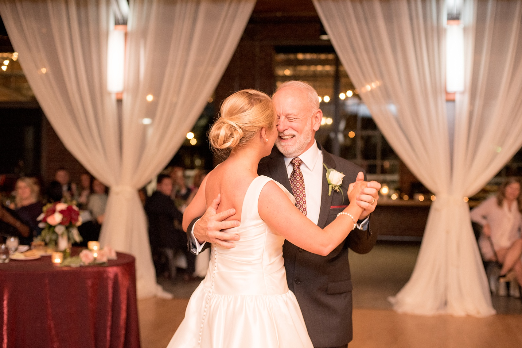 Mikkel Paige Photography photo of a wedding at The Rickhouse, NC. A picture of the bride dancing with her father.