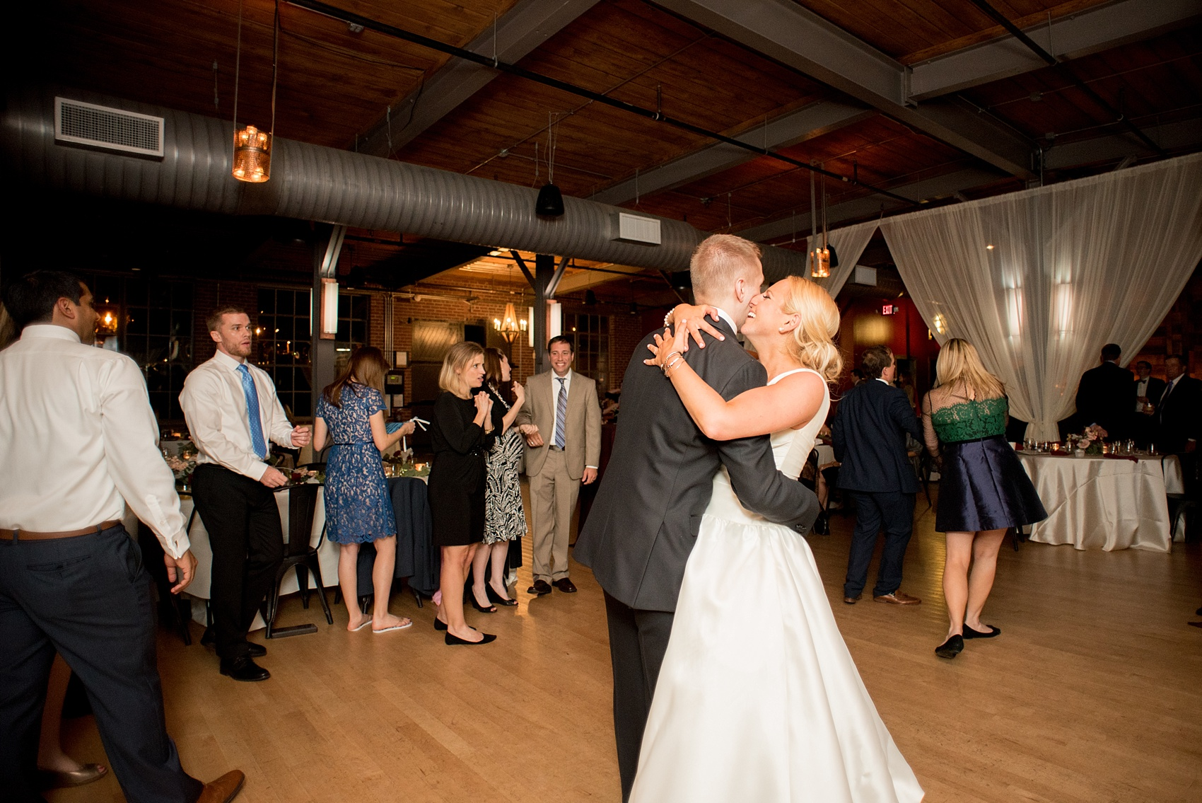Mikkel Paige Photography photo of a wedding at The Rickhouse, NC. A picture of bride and groom dancing during their reception.