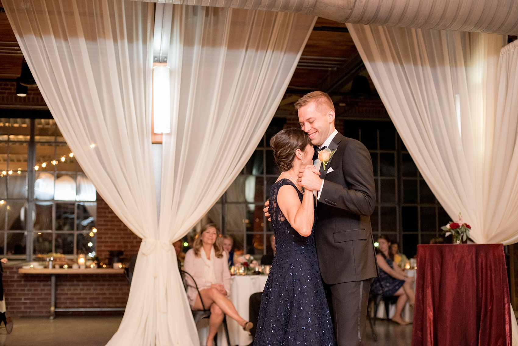 Mikkel Paige Photography photo of a wedding at The Rickhouse, NC. A picture of the groom dancing with his mother.
