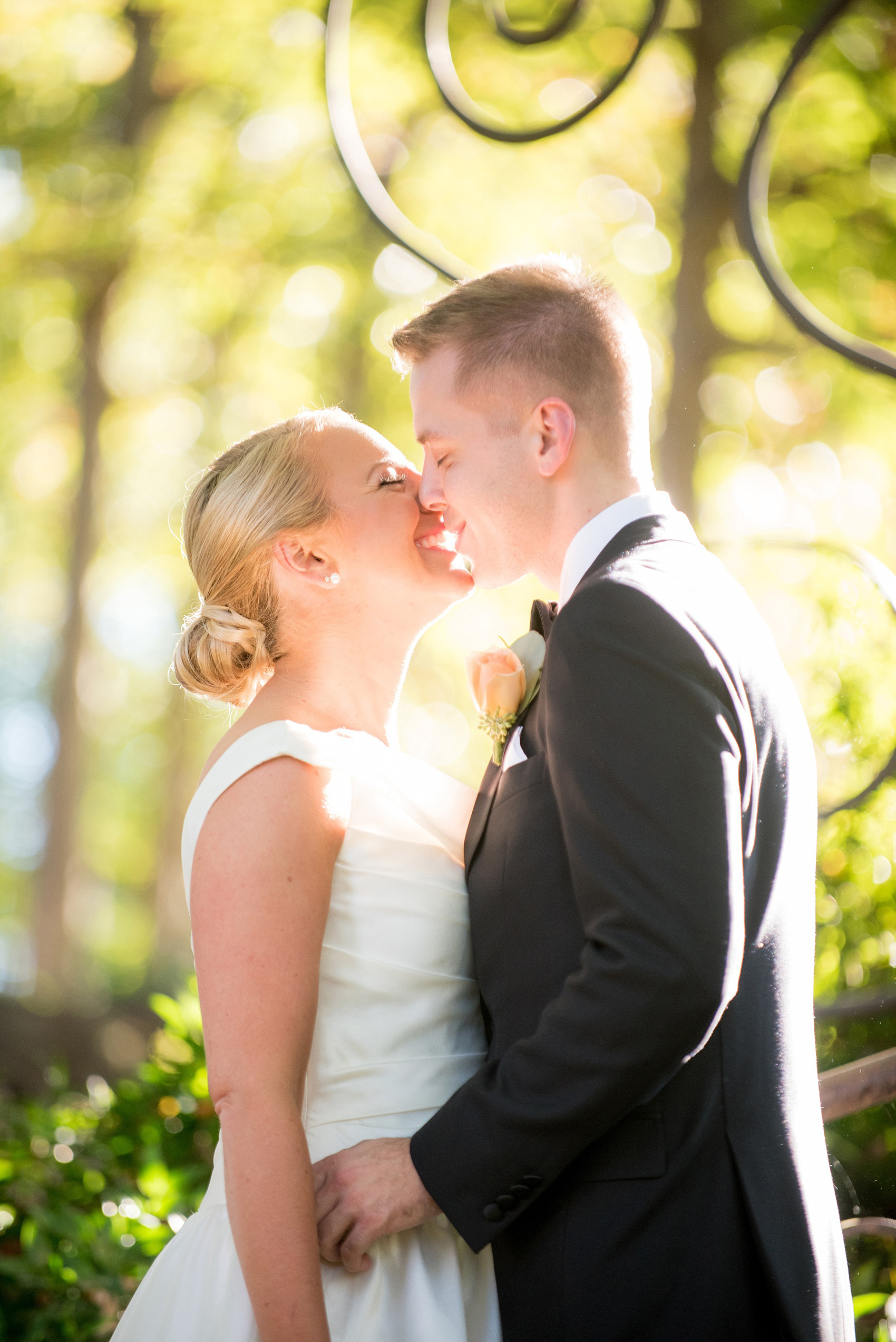 Mikkel Paige Photography photo of a wedding at The Rickhouse, North Carolina. The bride and groom kiss in Durham Central Park after their first look!