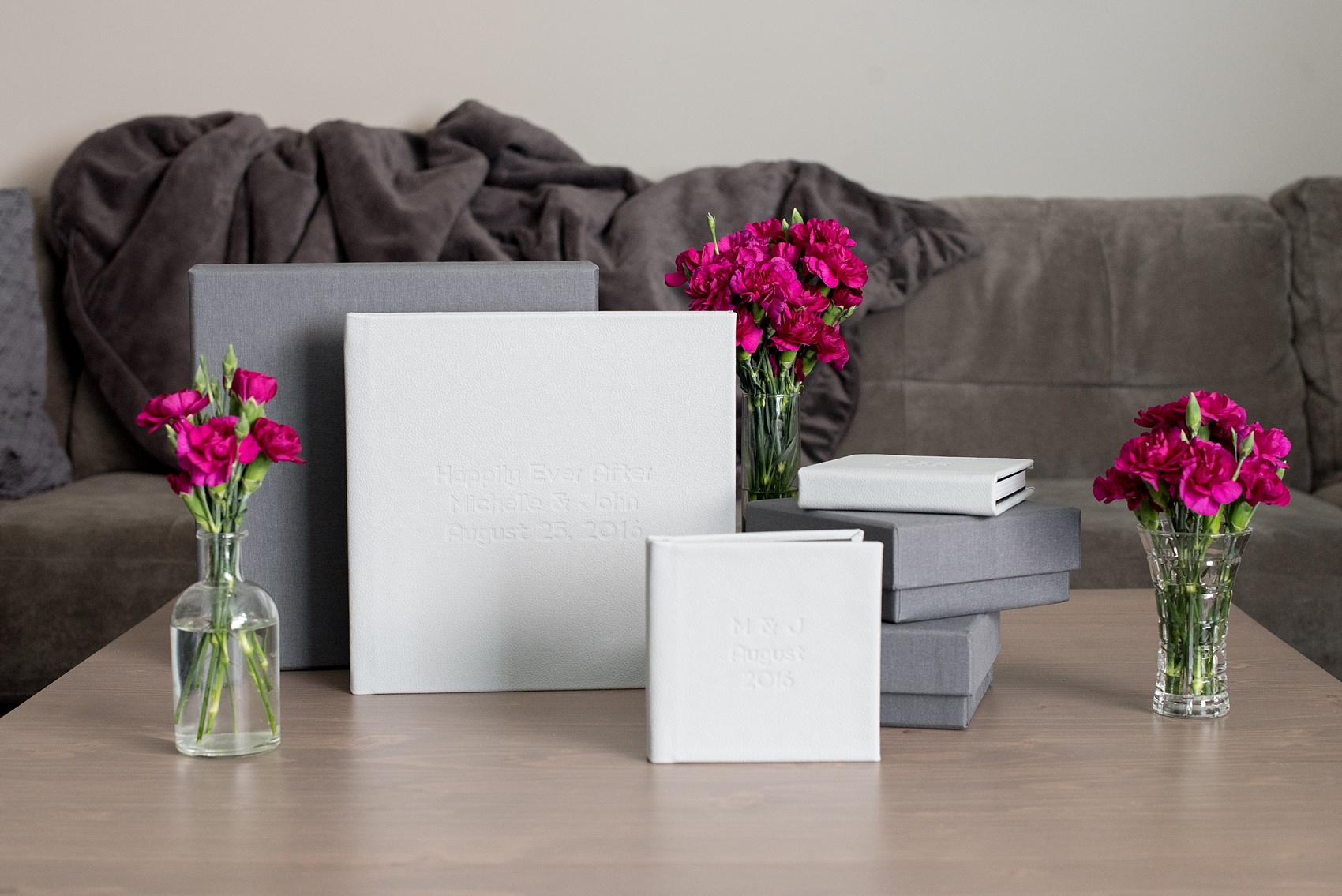 Wedding albums by Mikkel Paige Photography. Mist Leather Signature Album with matching parent albums for a wedding at India House, NYC.