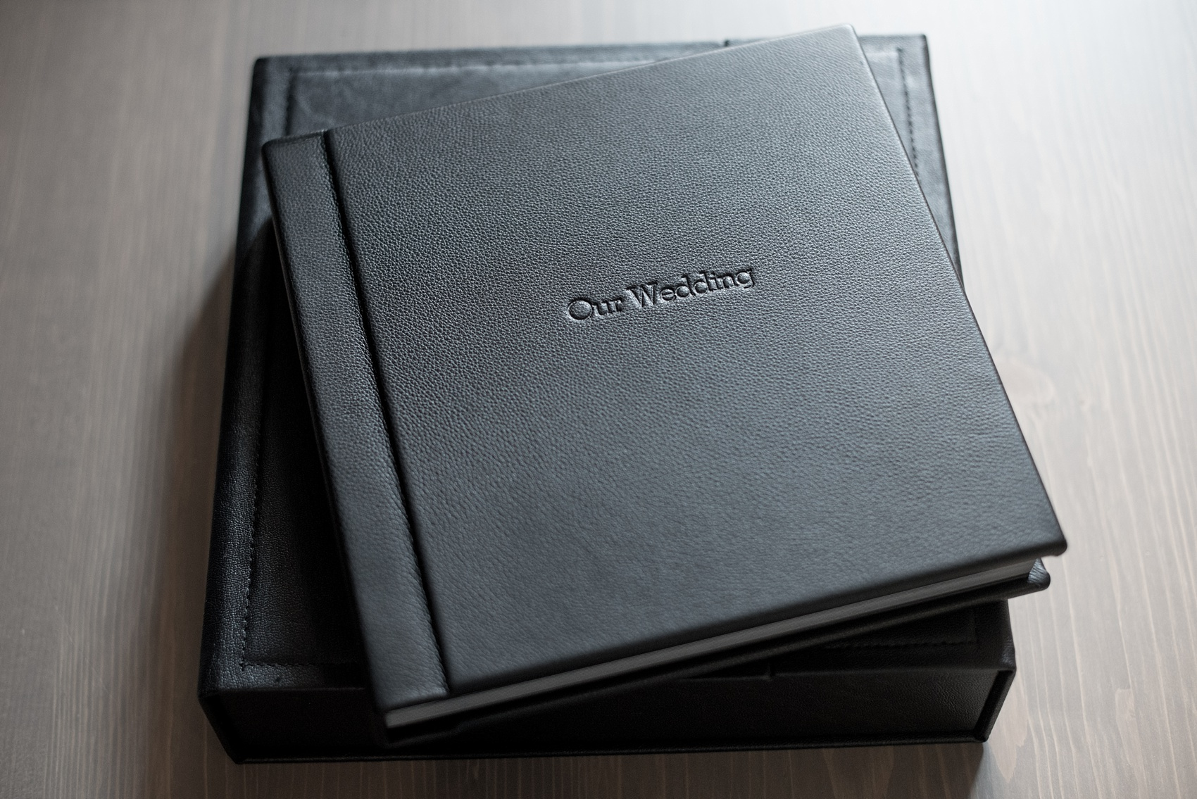Black leather wedding album by Mikkel Paige Photography of an event at Tribeca Rooftop in NYC.