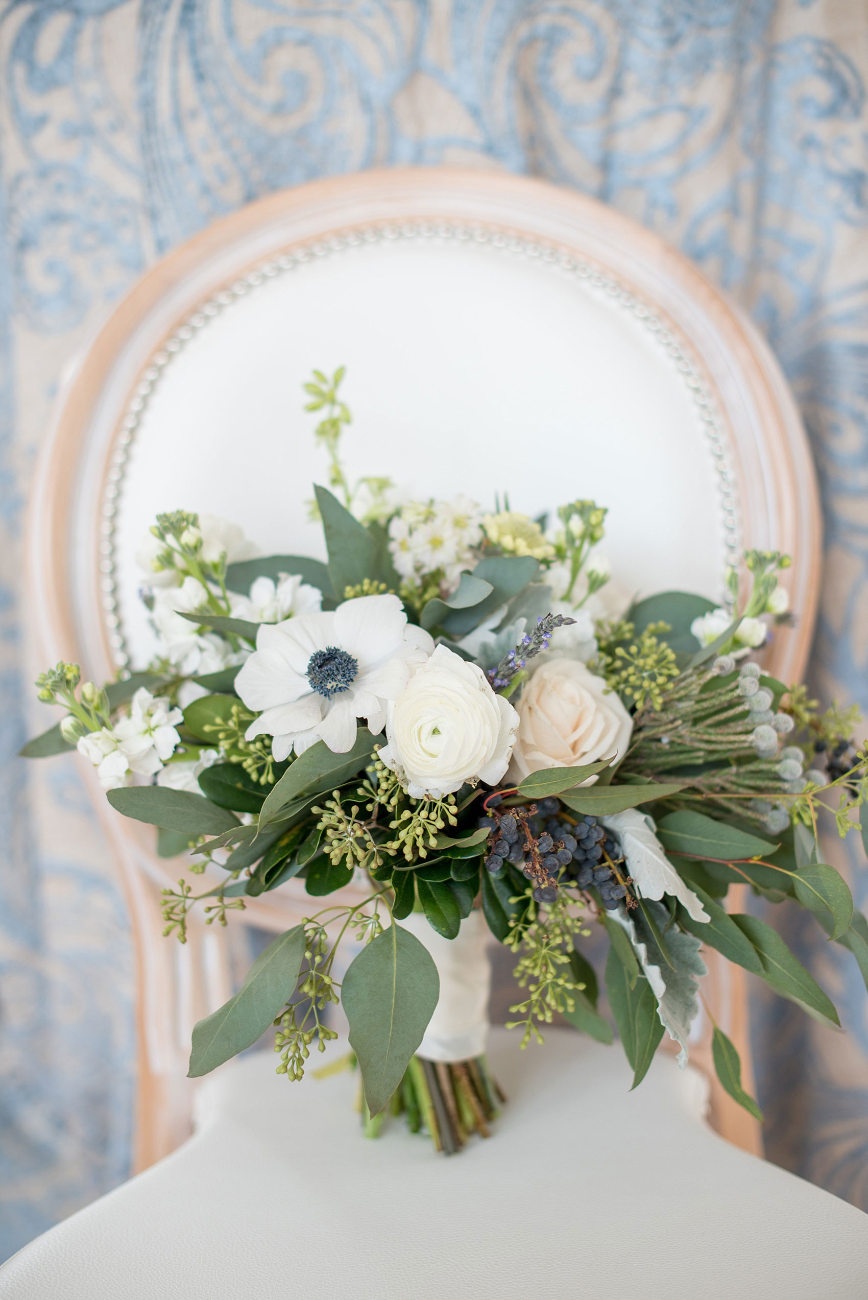 The Glass Box Raleigh wedding photos by Mikkel Paige Photography. Picture of a white bouquet with eucalyptus, anemones and lavender by Tre Bella.