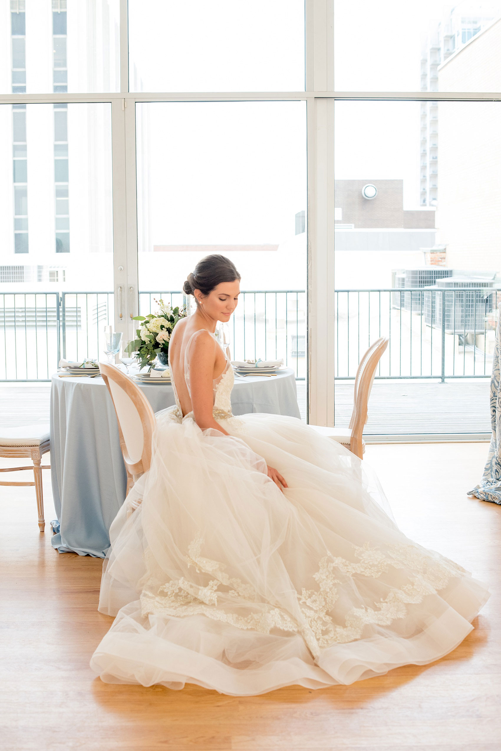 The Glass Box Raleigh wedding photos by Mikkel Paige Photography. Picture of the bride in a Lazaro gown in this modern downtown venue.