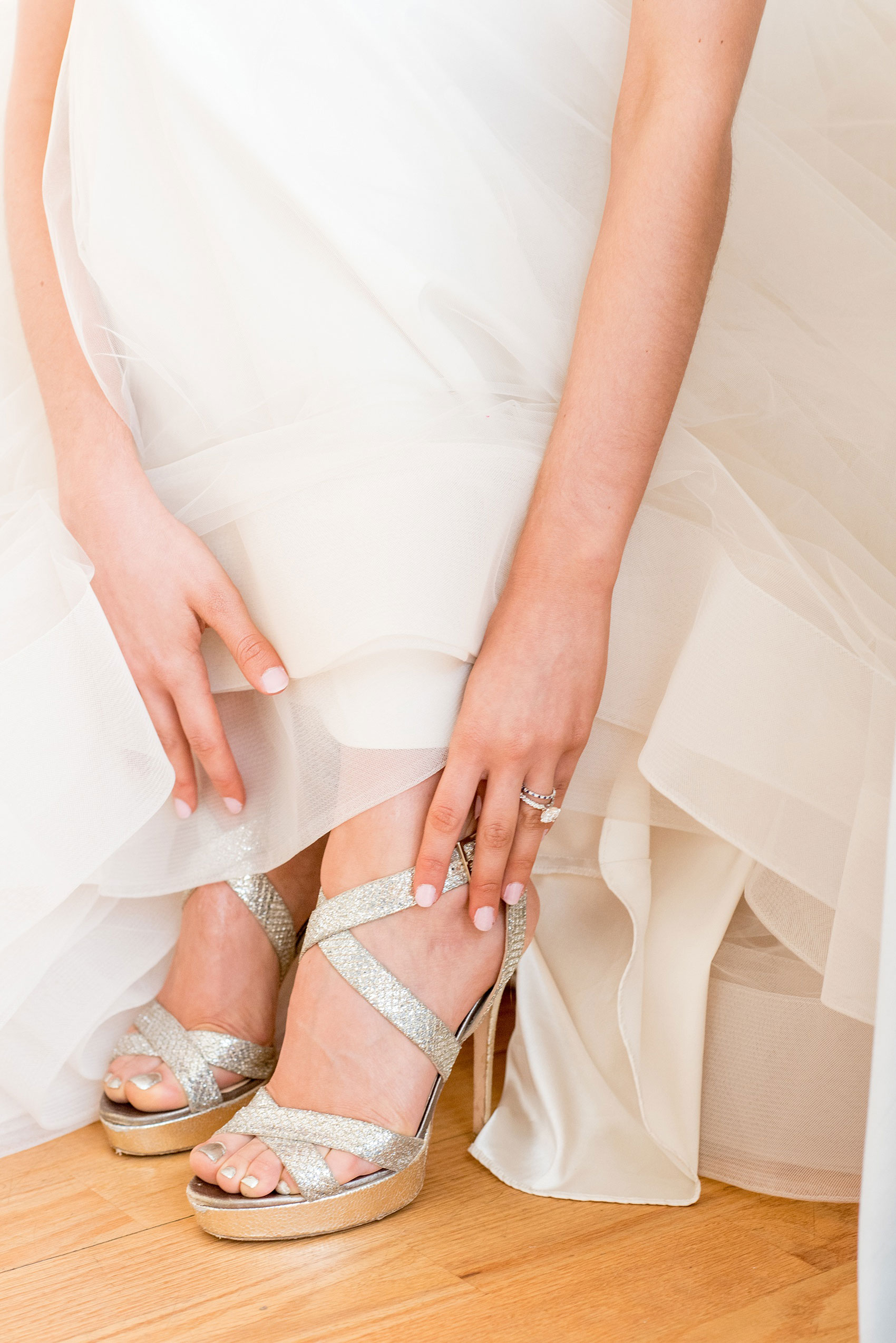 The Glass Box Raleigh wedding photos by Mikkel Paige Photography. Detail picture of the bride's metallic Jimmy Choo shoes.