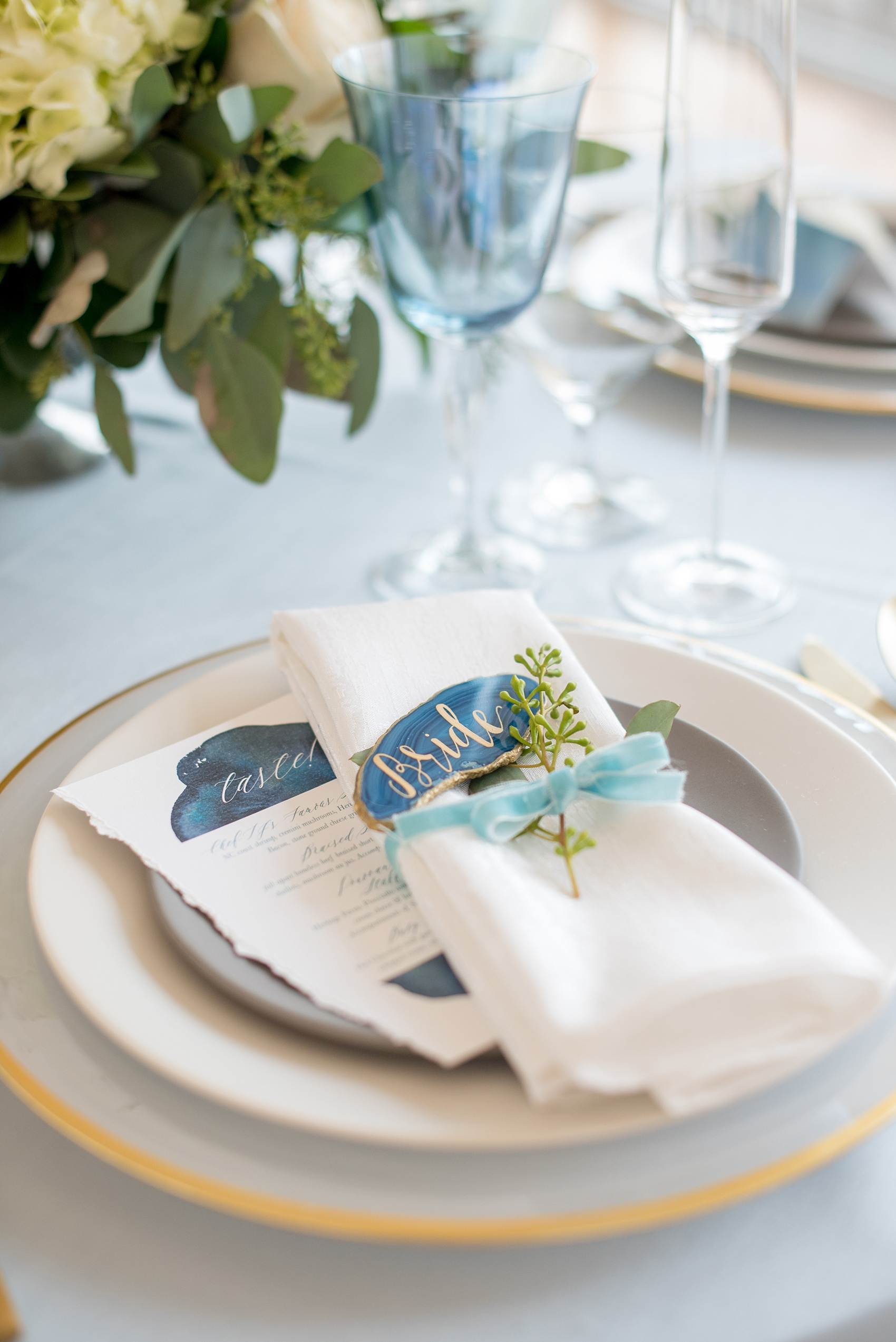 The Glass Box Raleigh wedding photos by Mikkel Paige Photography. Detail picture of the table setting with velvet ribbon and blue agate escort/place cards.