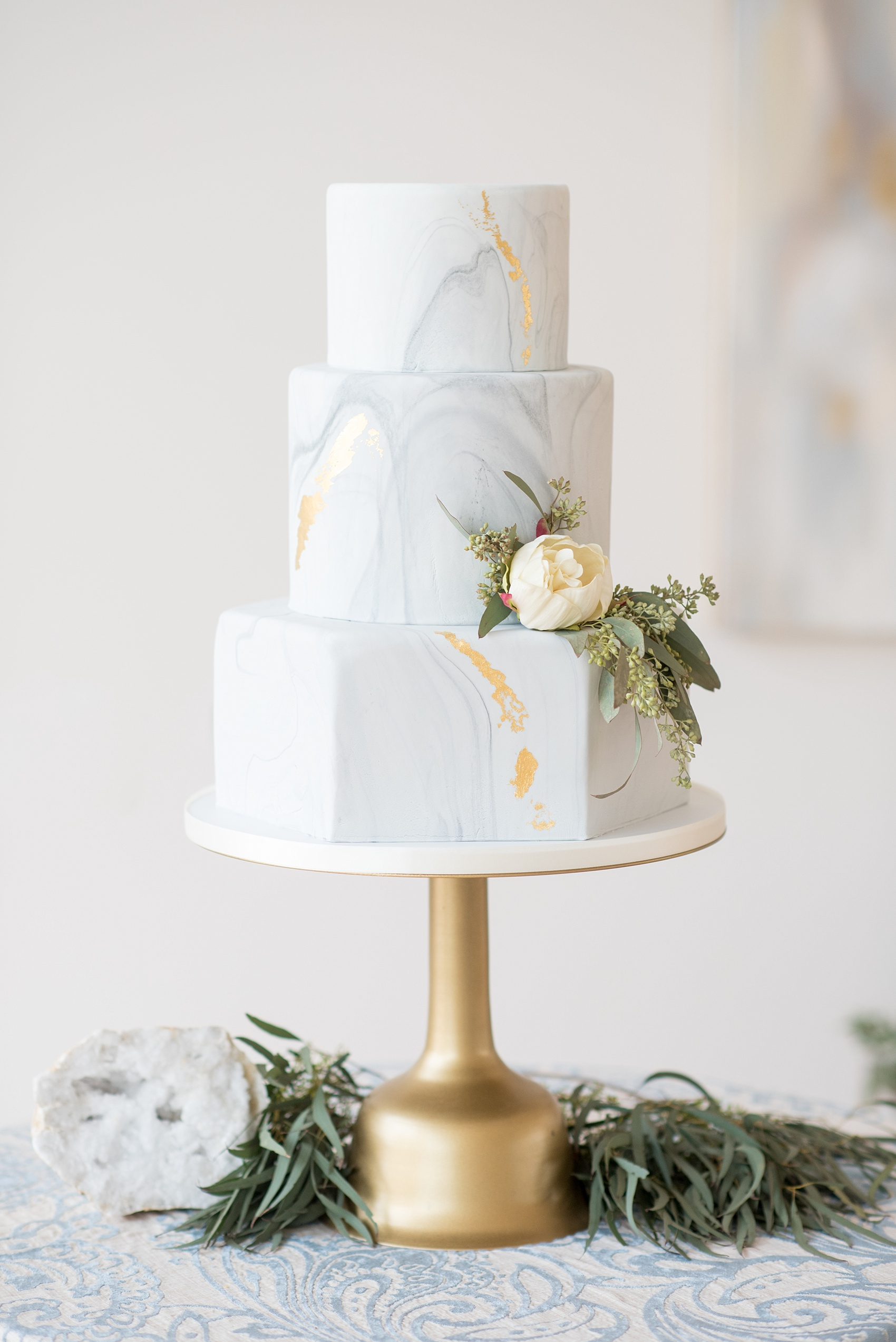The Glass Box Raleigh wedding photos by Mikkel Paige Photography. Picture of a grey and white marble hexagonal tiered cake.