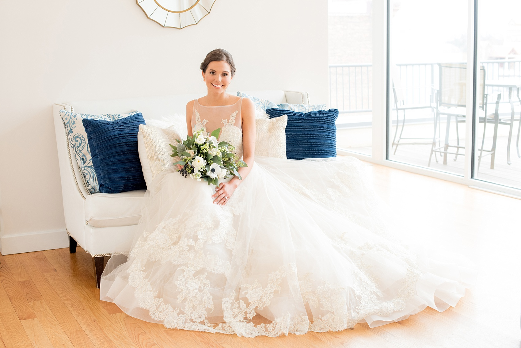 The Glass Box Raleigh wedding photos by Mikkel Paige Photography. Picture of the bride in a Lazaro gown in this modern downtown venue holding a bouquet of eucalyptus and anemones.