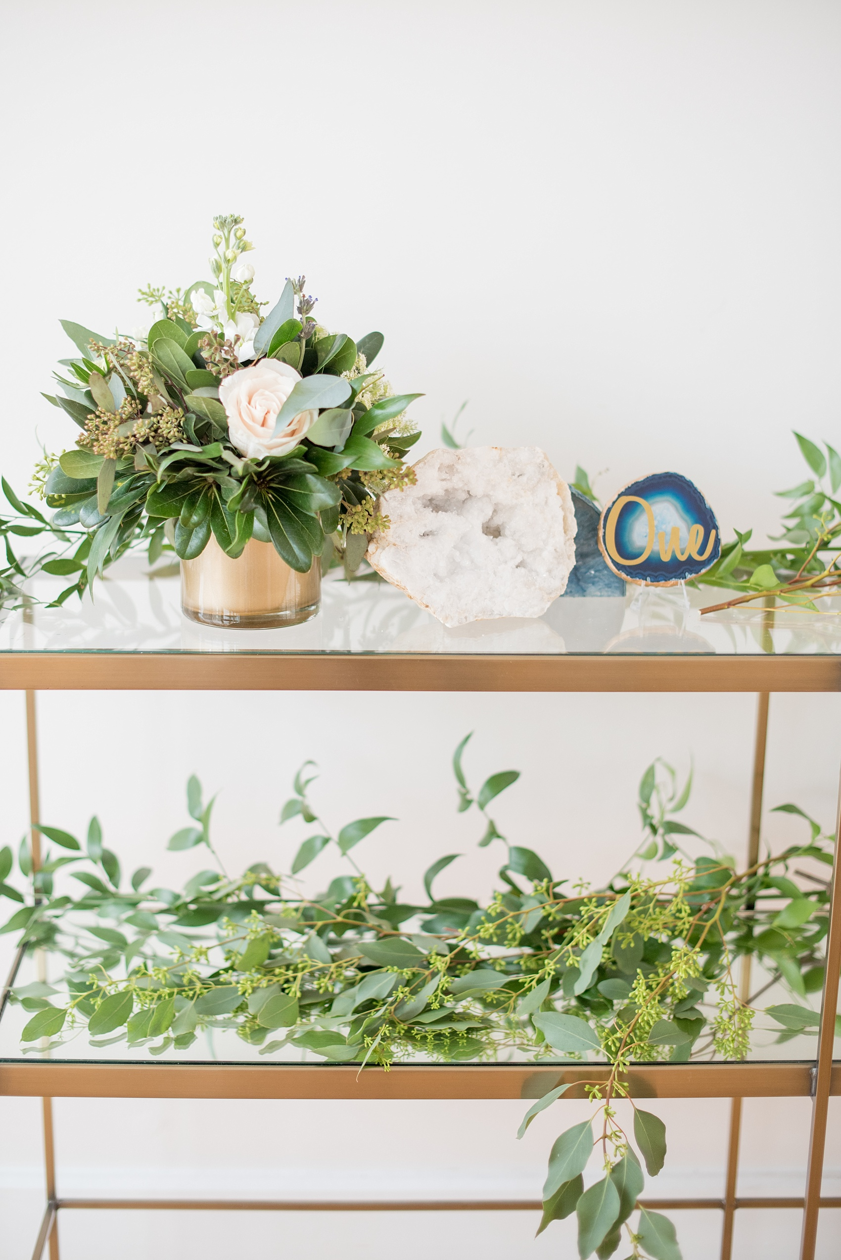 The Glass Box Raleigh wedding photos by Mikkel Paige Photography. Picture of geodes and greenery at this modern downtown venue.