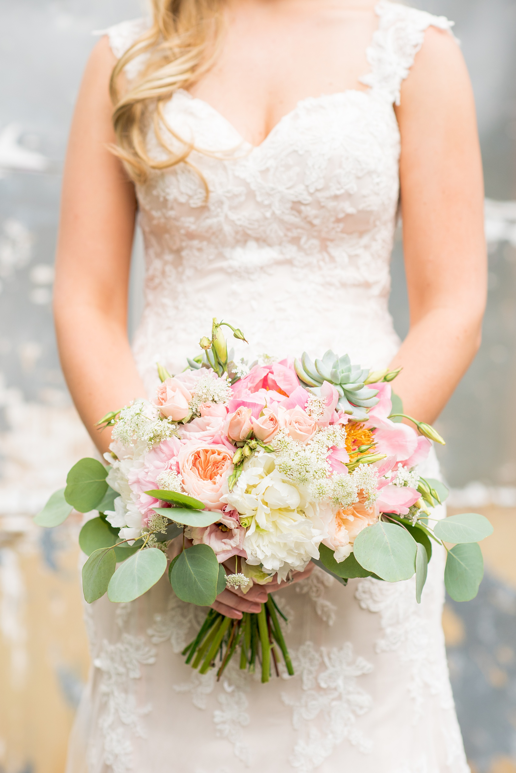Mikkel Paige Photography photos from a wedding in Durham, North Carolina. Picture of the bride's bouquet of peonies, succulents and eucalyptus by Teacup Floral.