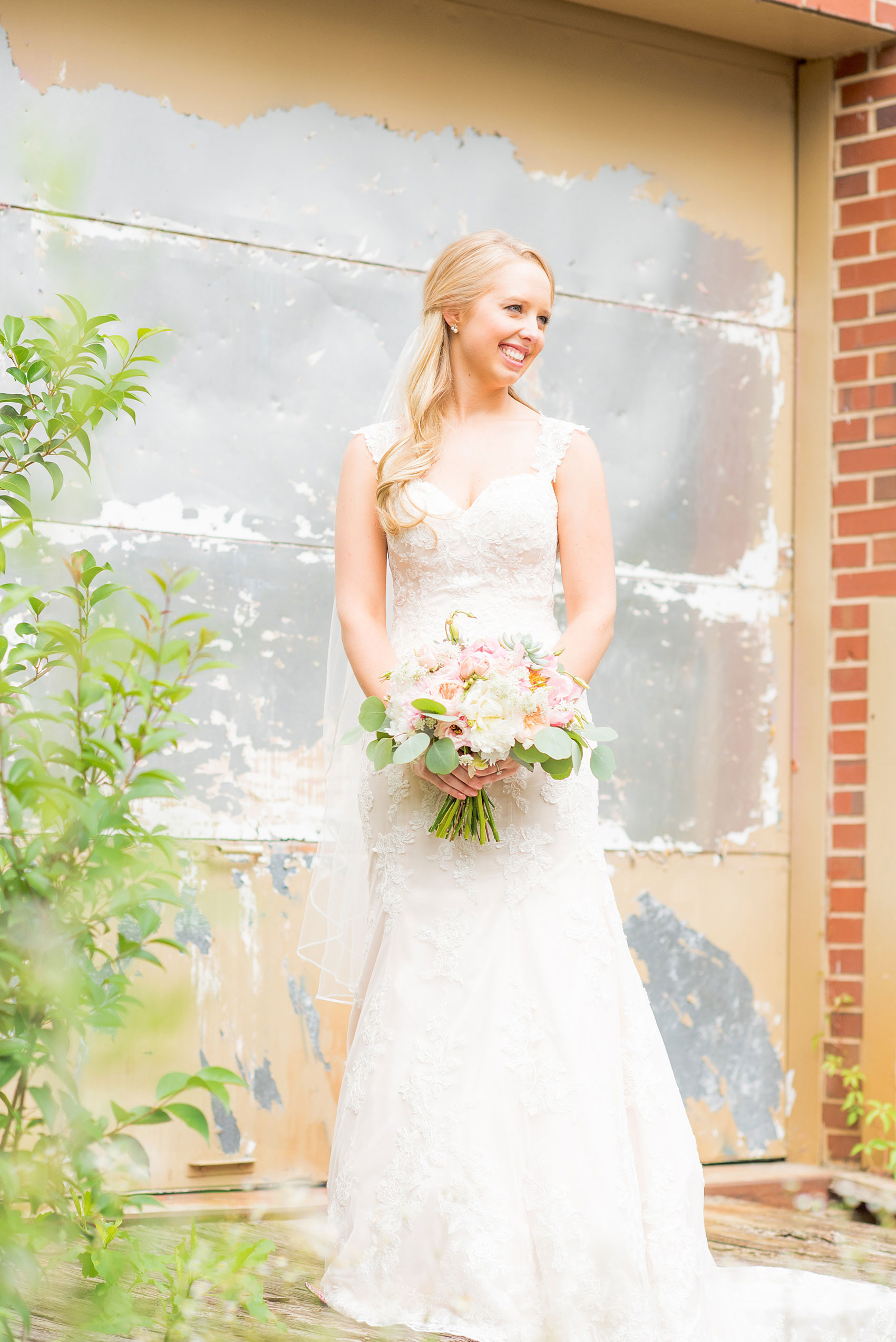 Mikkel Paige Photography photos from a wedding in Durham, North Carolina. Picture of the bride in an urban, rustic setting.