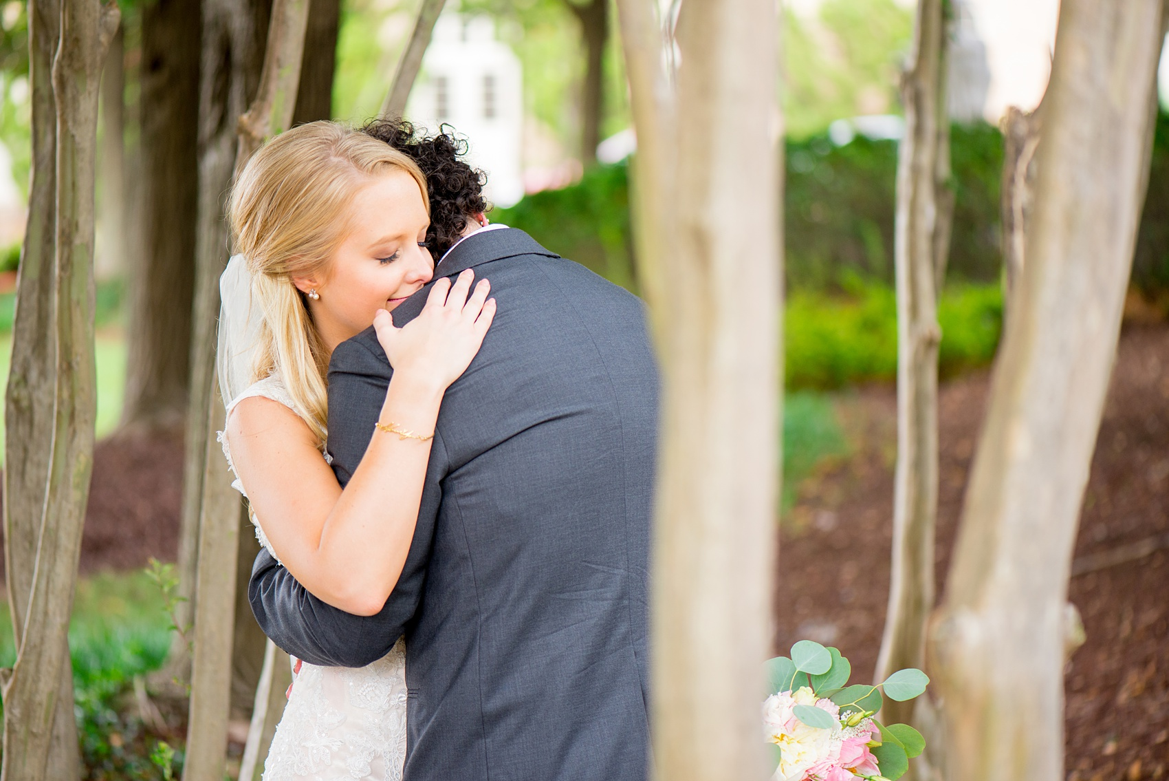 Mikkel Paige Photography photos from a wedding in Durham, North Carolina. Picture of the bride and groom hugging.