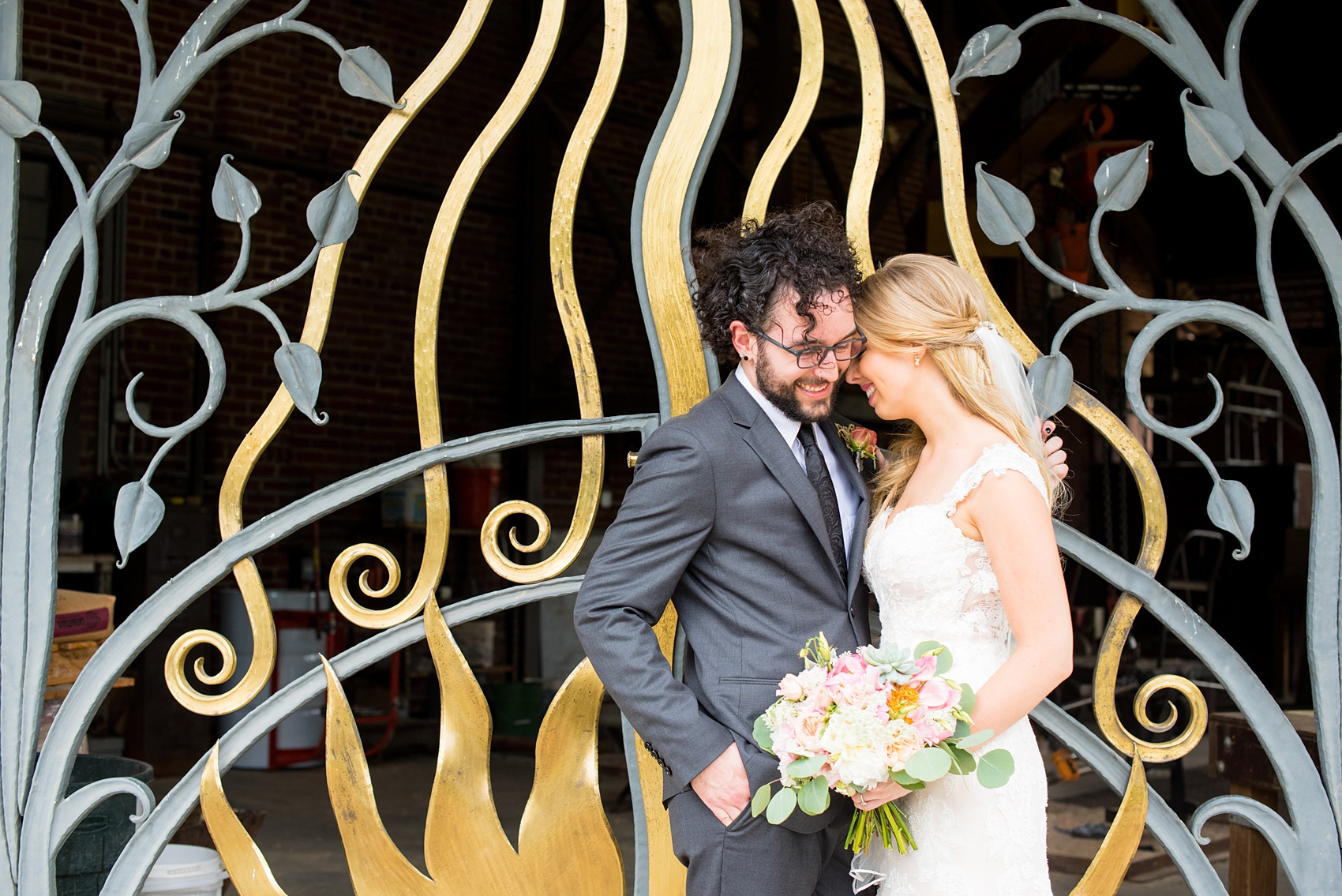 Mikkel Paige Photography photos from a wedding in Durham, North Carolina. Picture of the bride and groom in front of a black and gold gate.