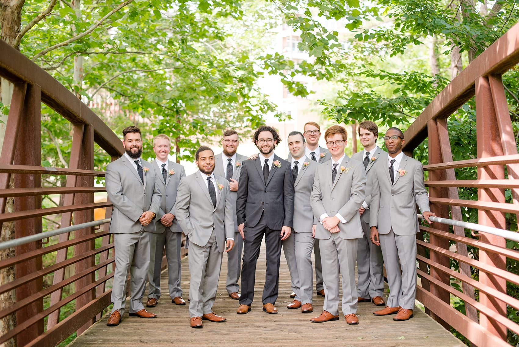 Mikkel Paige Photography photos from a wedding in Durham, North Carolina. Casual picture of the groomsmen on a rustic bridge downtown.
