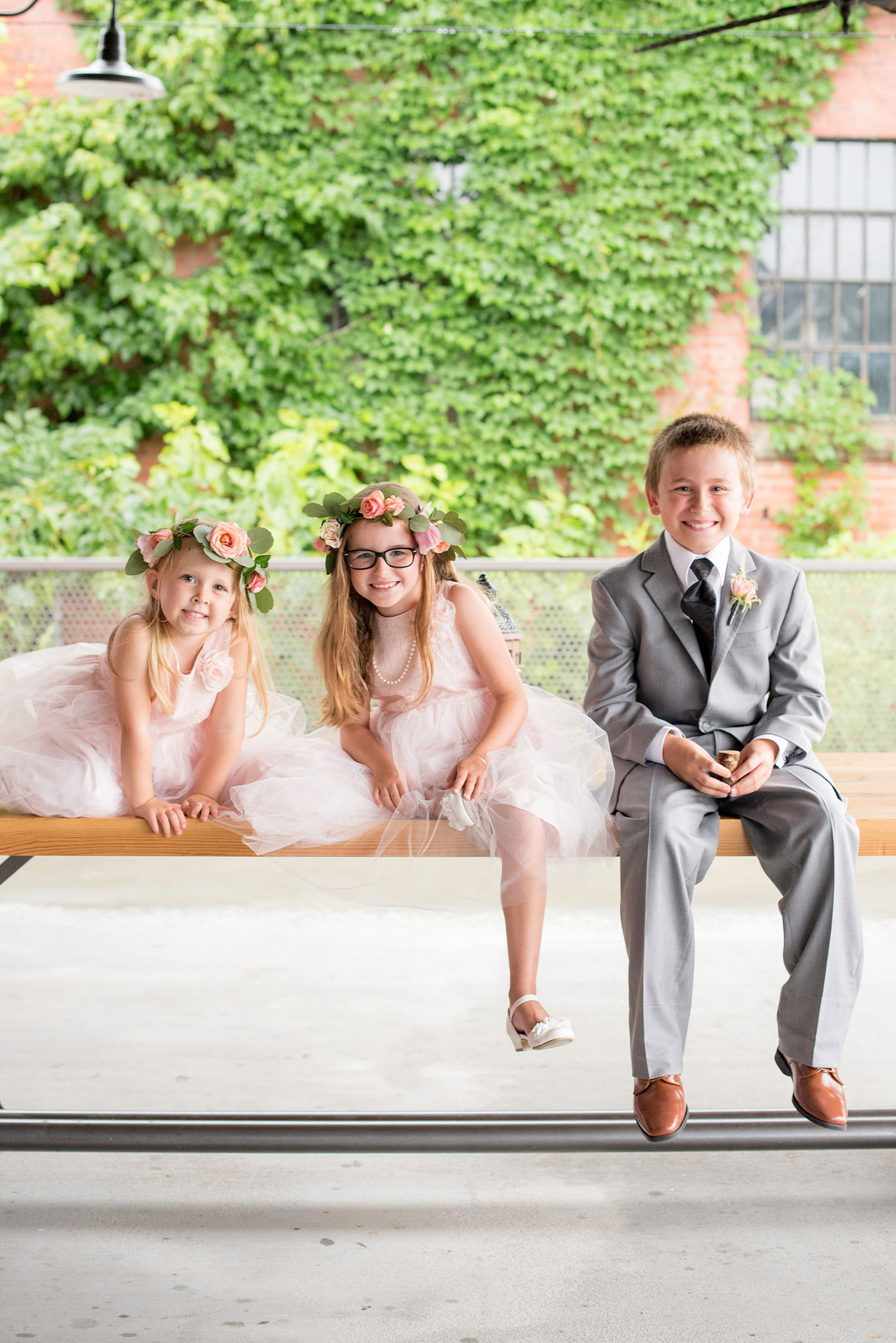Mikkel Paige Photography photos from a wedding at The Rickhouse in Durham, North Carolina. Picture of the flower girls and ring bearer before the ceremony.