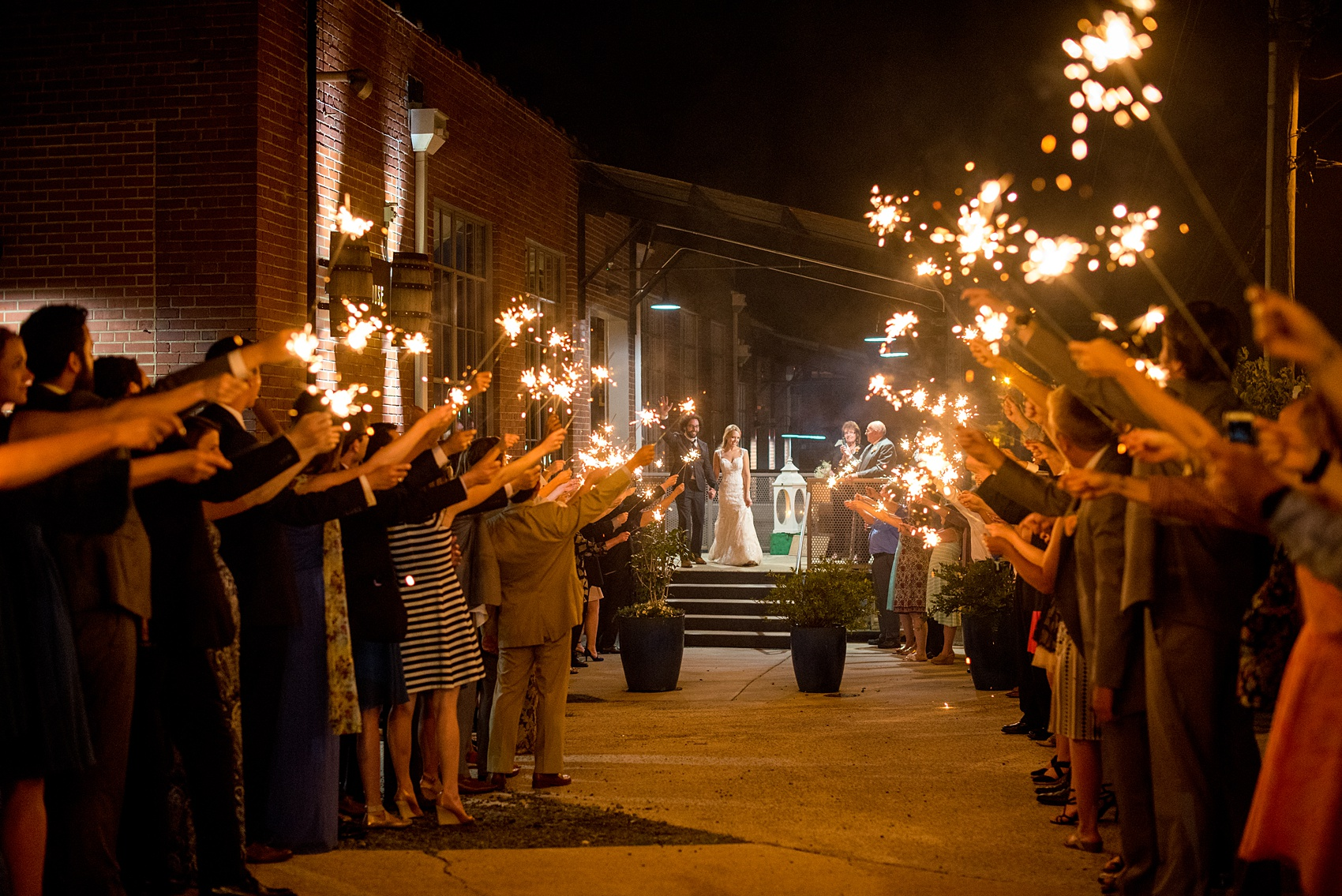 Mikkel Paige Photography photos from a wedding at The Rickhouse in Durham, North Carolina. Picture of the couple's sparkler exit.