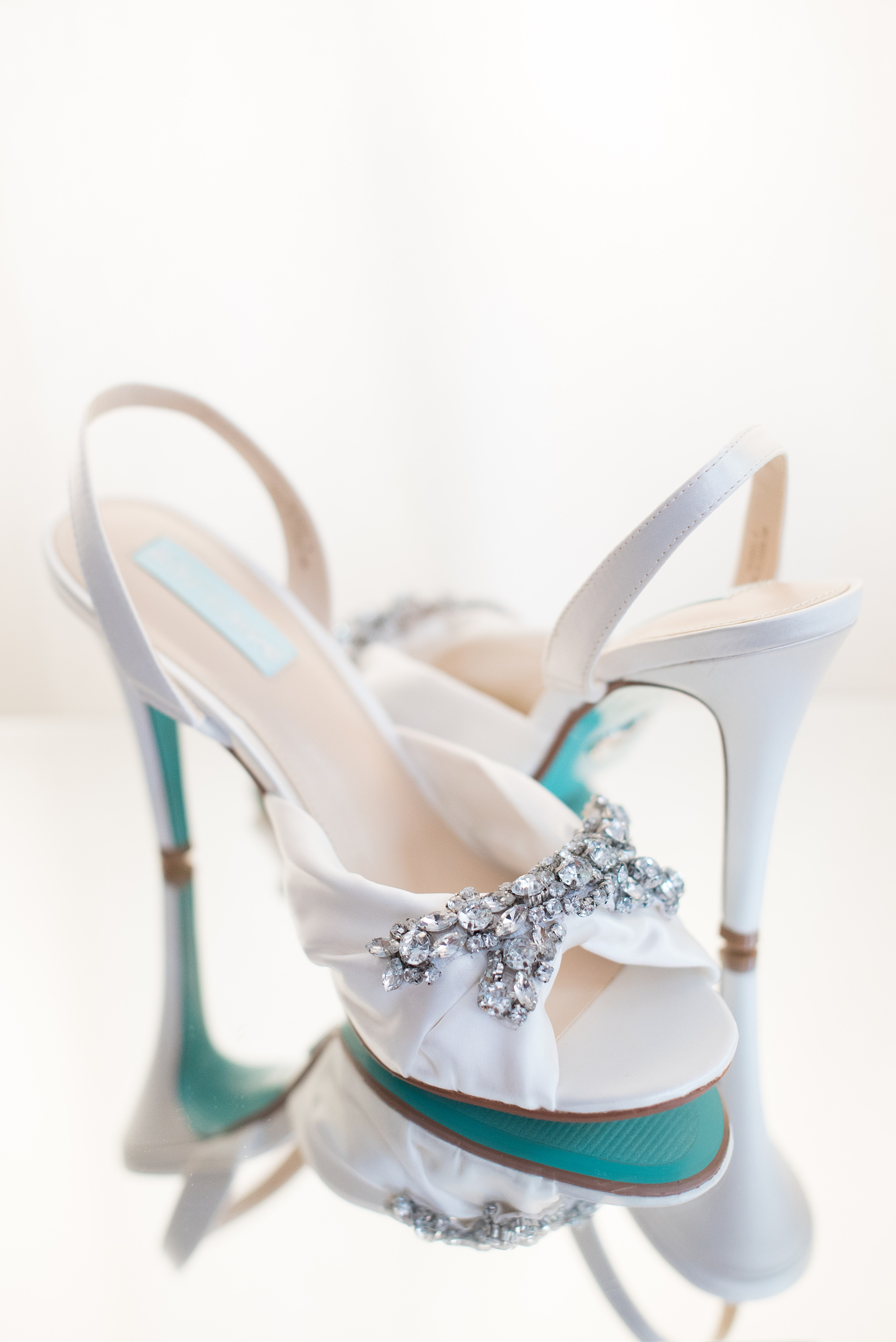 Mikkel Paige Photography pictures of a wedding at Leslie-Alford Mim's House in North Carolina for a Mad Dash Weddings event. Photo of the bride's blue-soled Betsey Johnson rhinestone bridal day shoes.